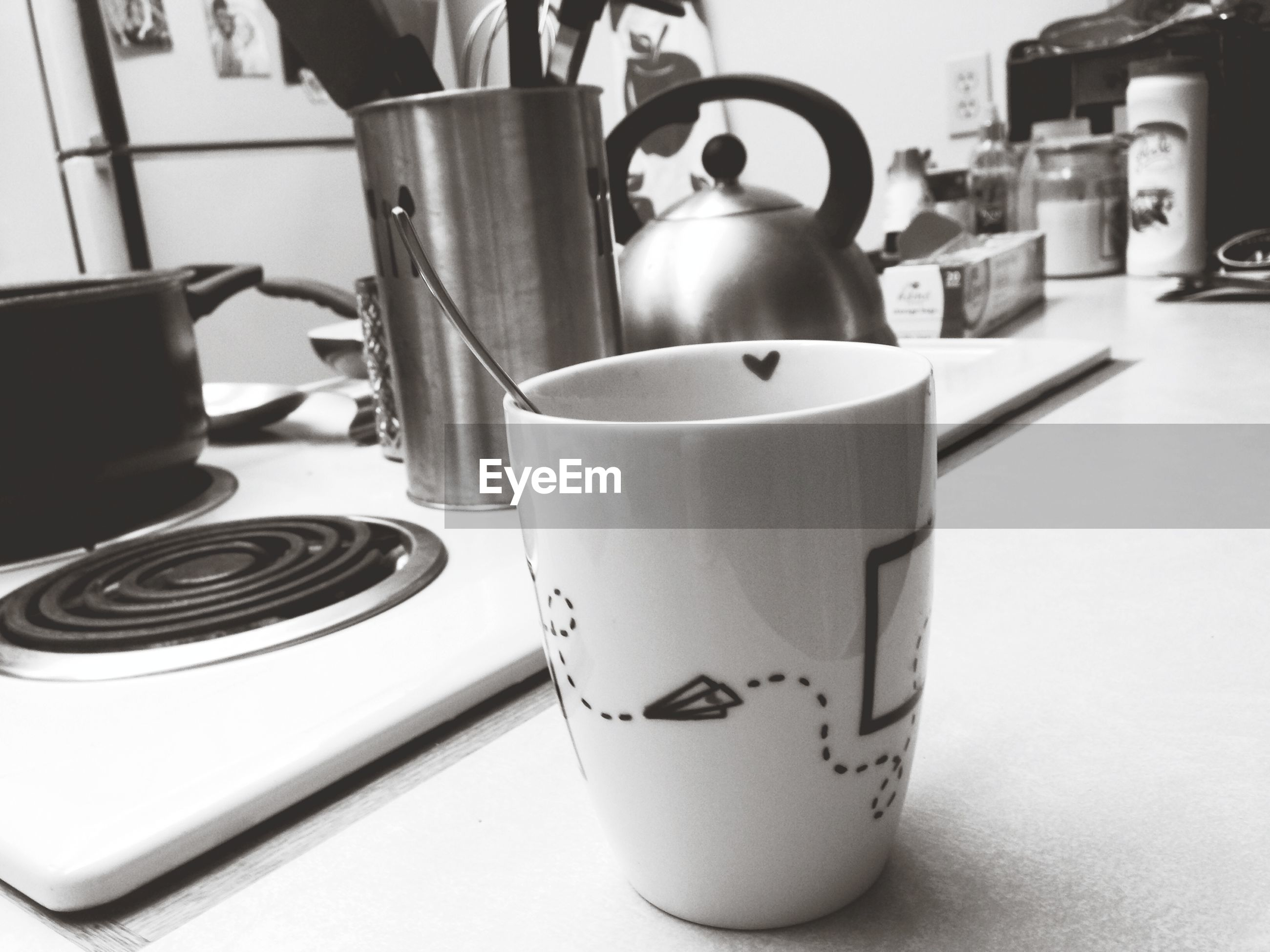indoors, drink, coffee cup, food and drink, table, refreshment, coffee - drink, cup, still life, saucer, coffee, close-up, tea cup, freshness, spoon, cafe, beverage, focus on foreground, technology, frothy drink