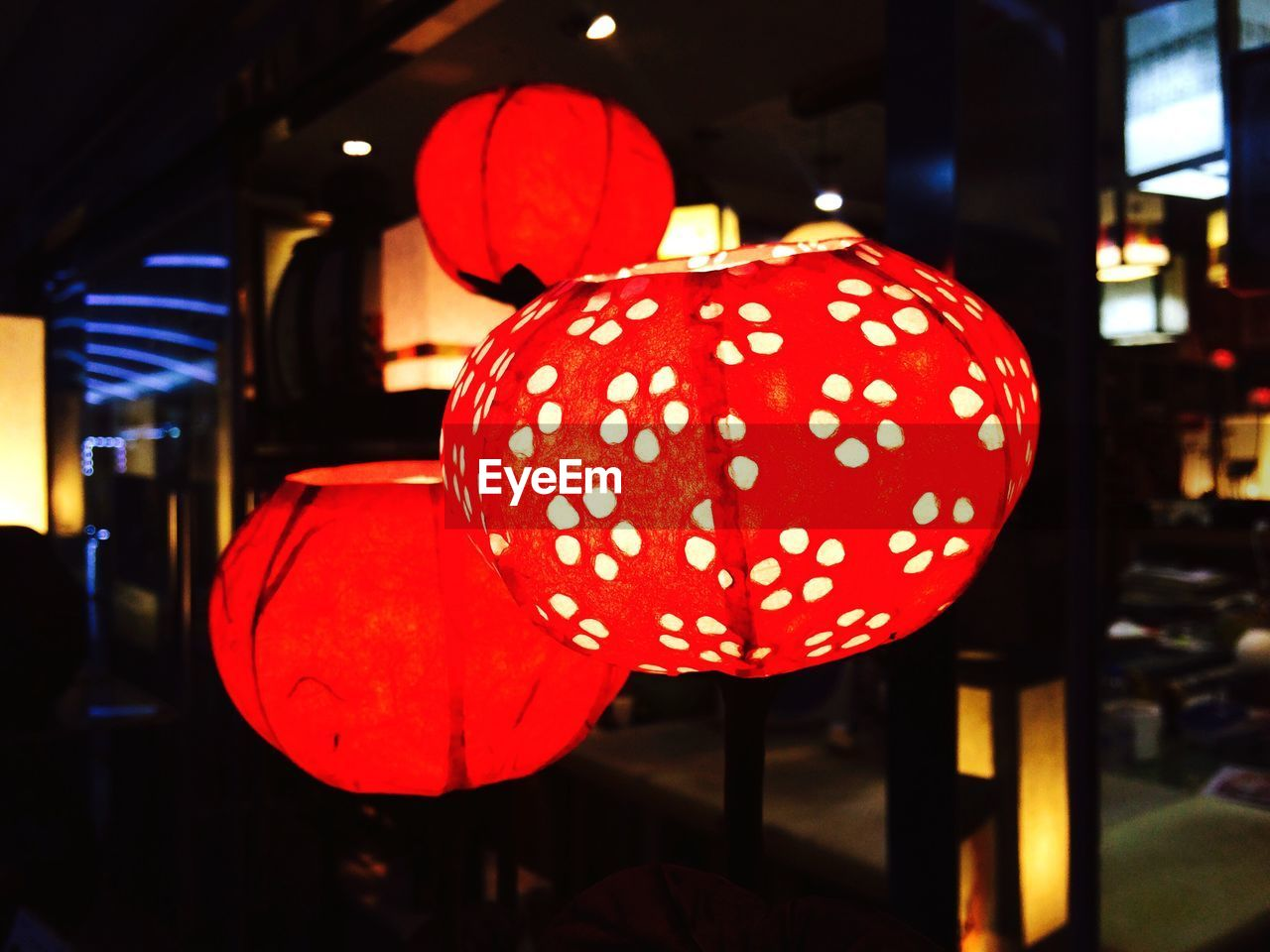 red, illuminated, focus on foreground, night, no people, lantern, close-up, indoors