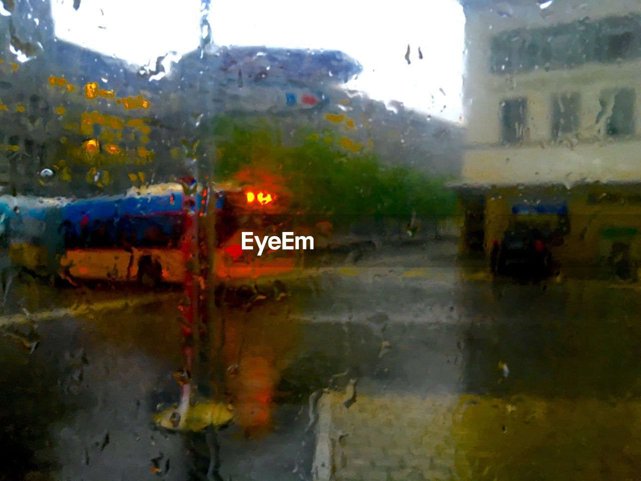 glass - material, rain, wet, window, rainy season, transportation, land vehicle, car, weather, drop, raindrop, water, mode of transport, no people, day, outdoors, close-up, sky