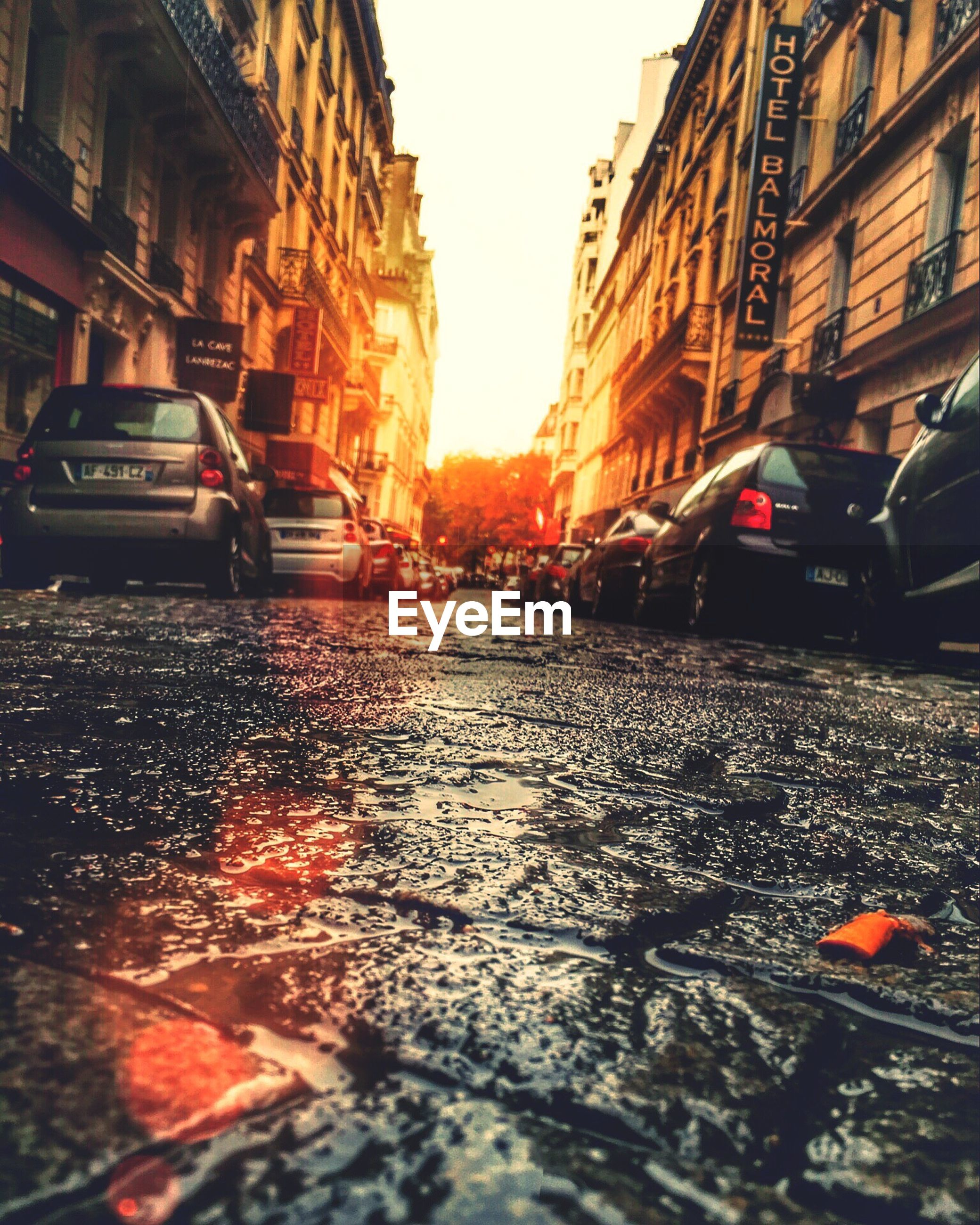 car, land vehicle, transportation, mode of transport, wet, city, yellow taxi, street, rain, traffic, road, water, no people, outdoors, day