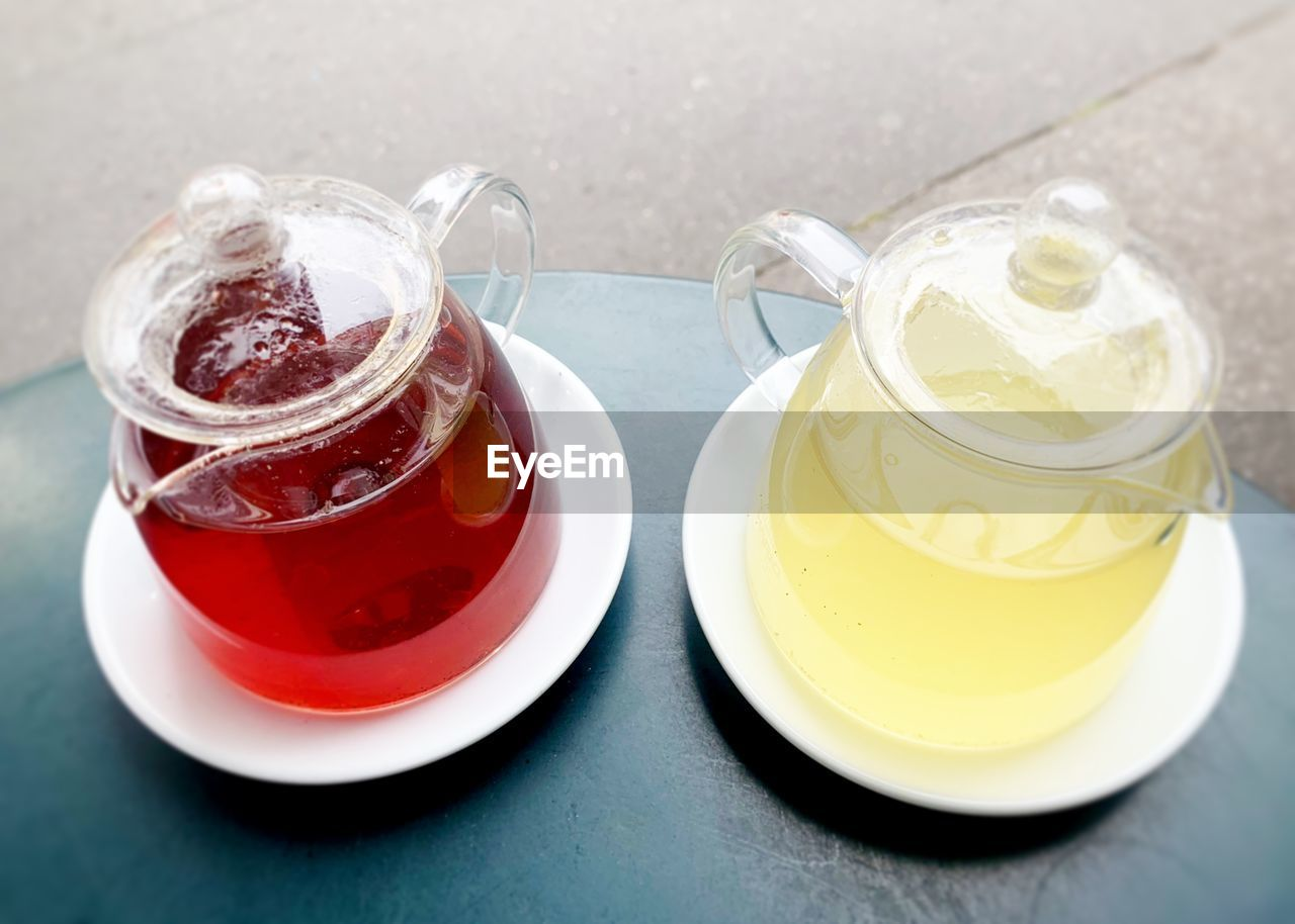 food and drink, table, still life, refreshment, drink, freshness, no people, cup, food, close-up, indoors, high angle view, mug, saucer, spoon, kitchen utensil, crockery, eating utensil, container, ready-to-eat, glass, temptation, tea cup, teapot