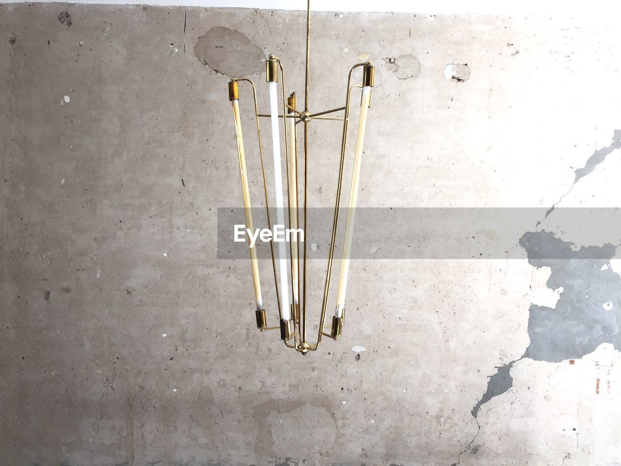Lighting Equipment Hanging Against Weathered Wall