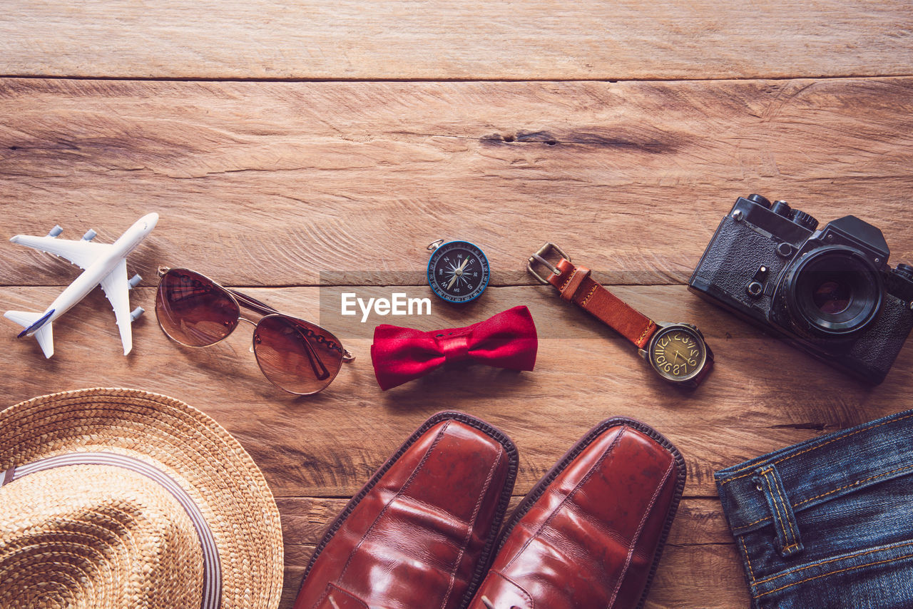 High Angle View Of Menswear On Wooden Table