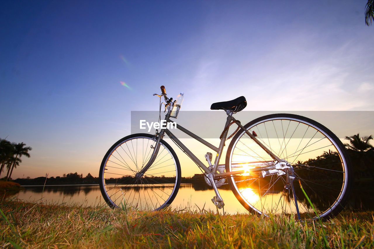 Silhouette Bicycle Against Sky At Sunset
