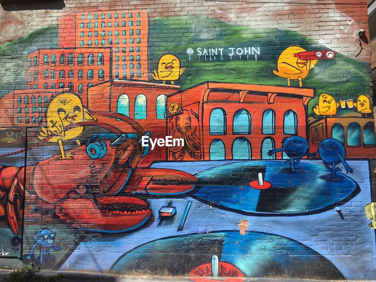 art and craft, text, creativity, graffiti, representation, multi colored, architecture, built structure, street art, no people, western script, day, communication, human representation, wall - building feature, wall, craft, city, outdoors, mural