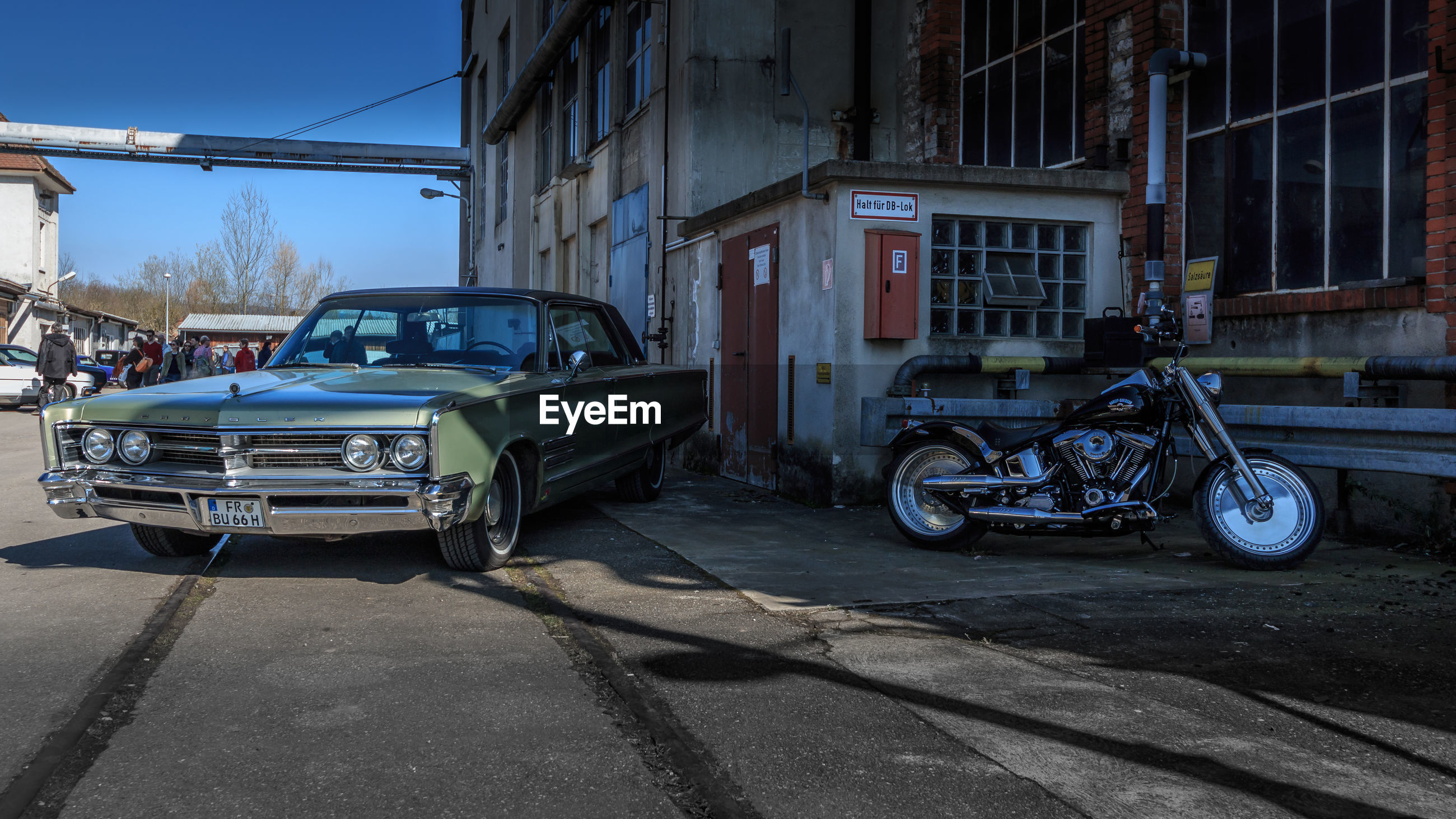 transportation, mode of transportation, land vehicle, motor vehicle, car, architecture, city, building exterior, built structure, road, street, vintage car, retro styled, building, day, outdoors, damaged, no people, stationary, garage