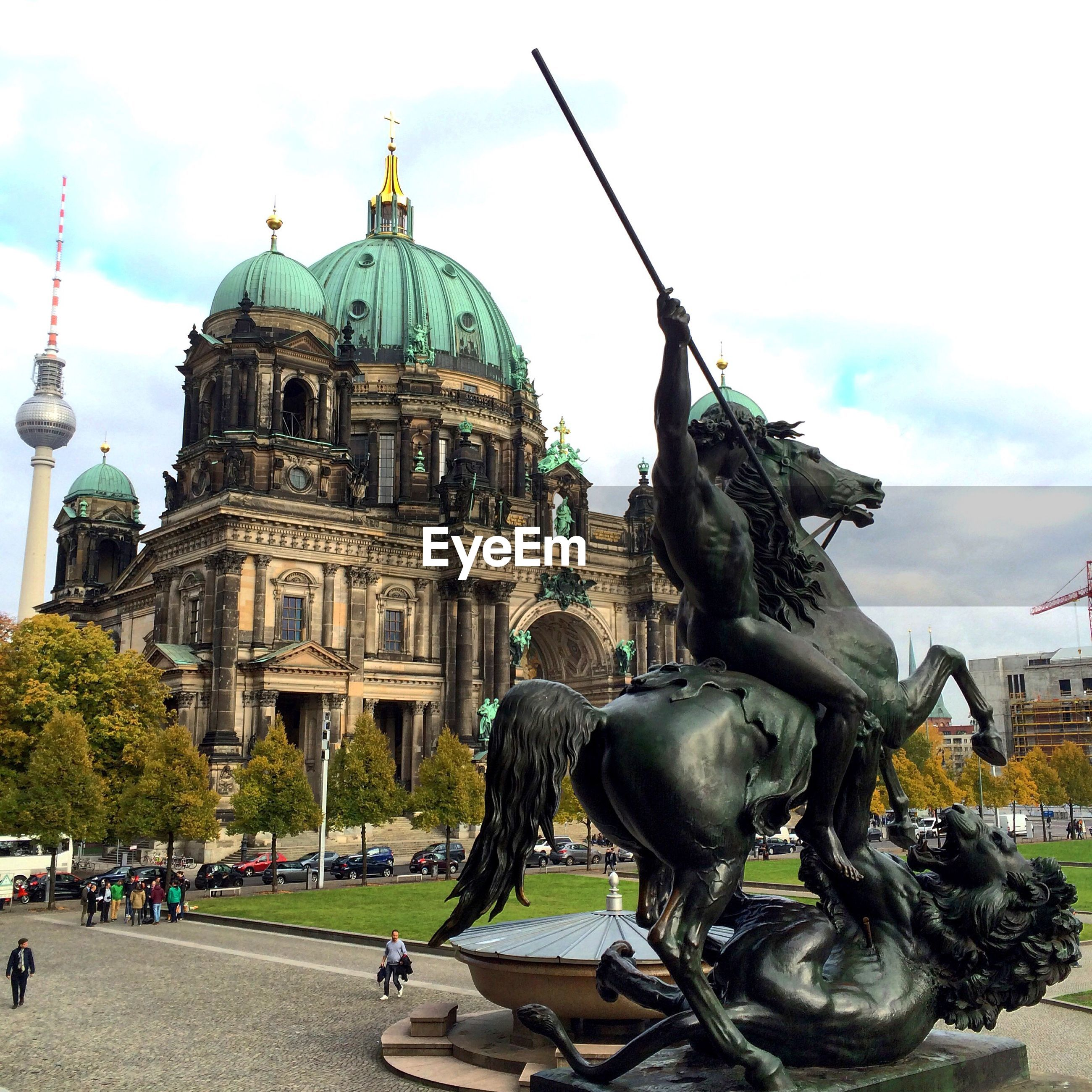 Statue at berlin cathedral against sky