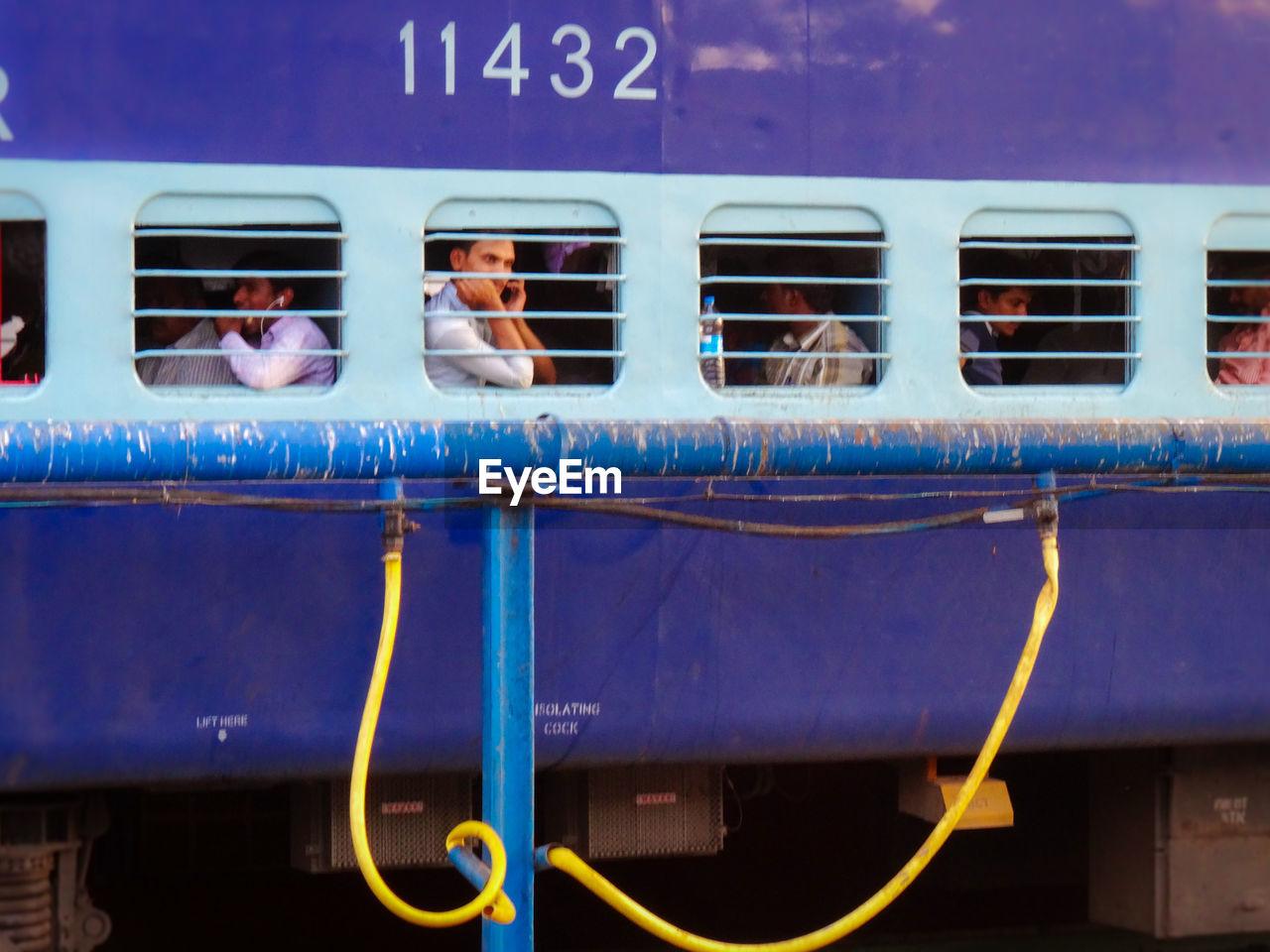 mode of transport, transportation, train - vehicle, public transportation, land vehicle, communication, blue, day, men, outdoors