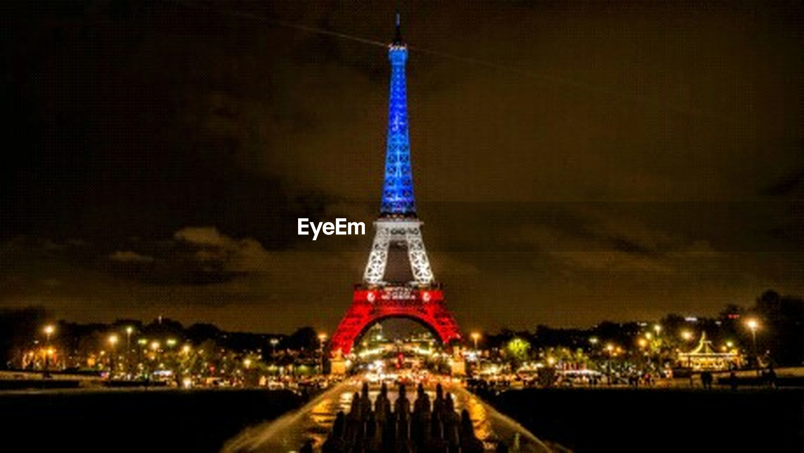 illuminated, built structure, night, architecture, famous place, international landmark, travel destinations, capital cities, tourism, city, tower, tall - high, sky, eiffel tower, travel, building exterior, dusk, engineering, connection, metal