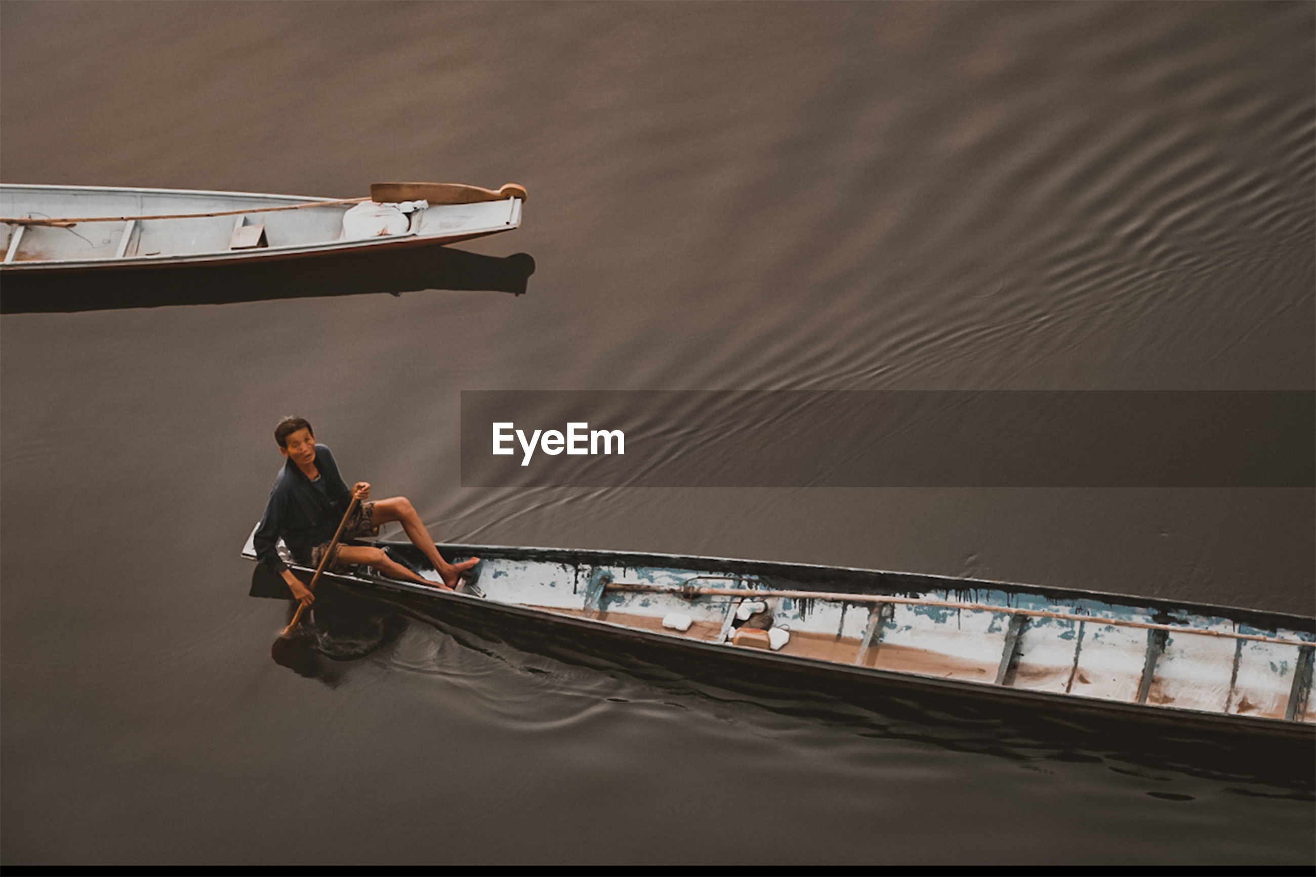 High angle view of man sitting in boat on sea
