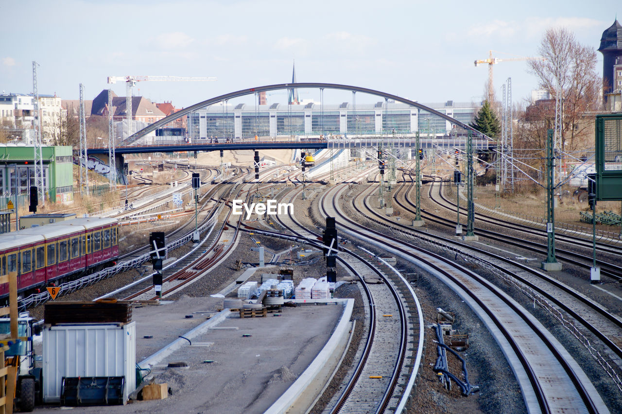 High angle view of railroad tracks against arch bridge