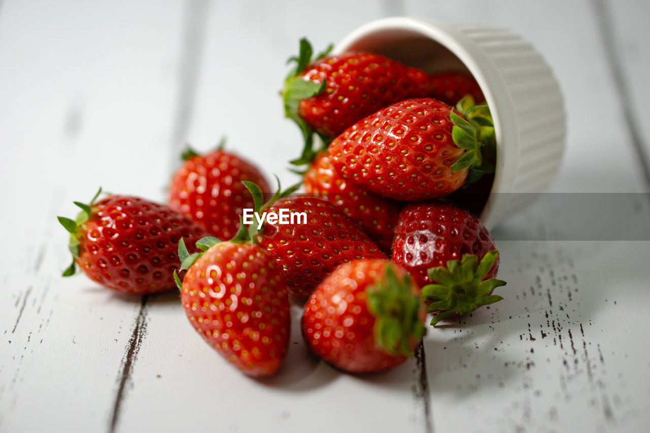 strawberry, berry fruit, healthy eating, fruit, food and drink, food, red, freshness, wellbeing, indoors, still life, table, close-up, no people, juicy, selective focus, high angle view, bowl, group of objects, kitchen utensil, ripe, antioxidant, temptation
