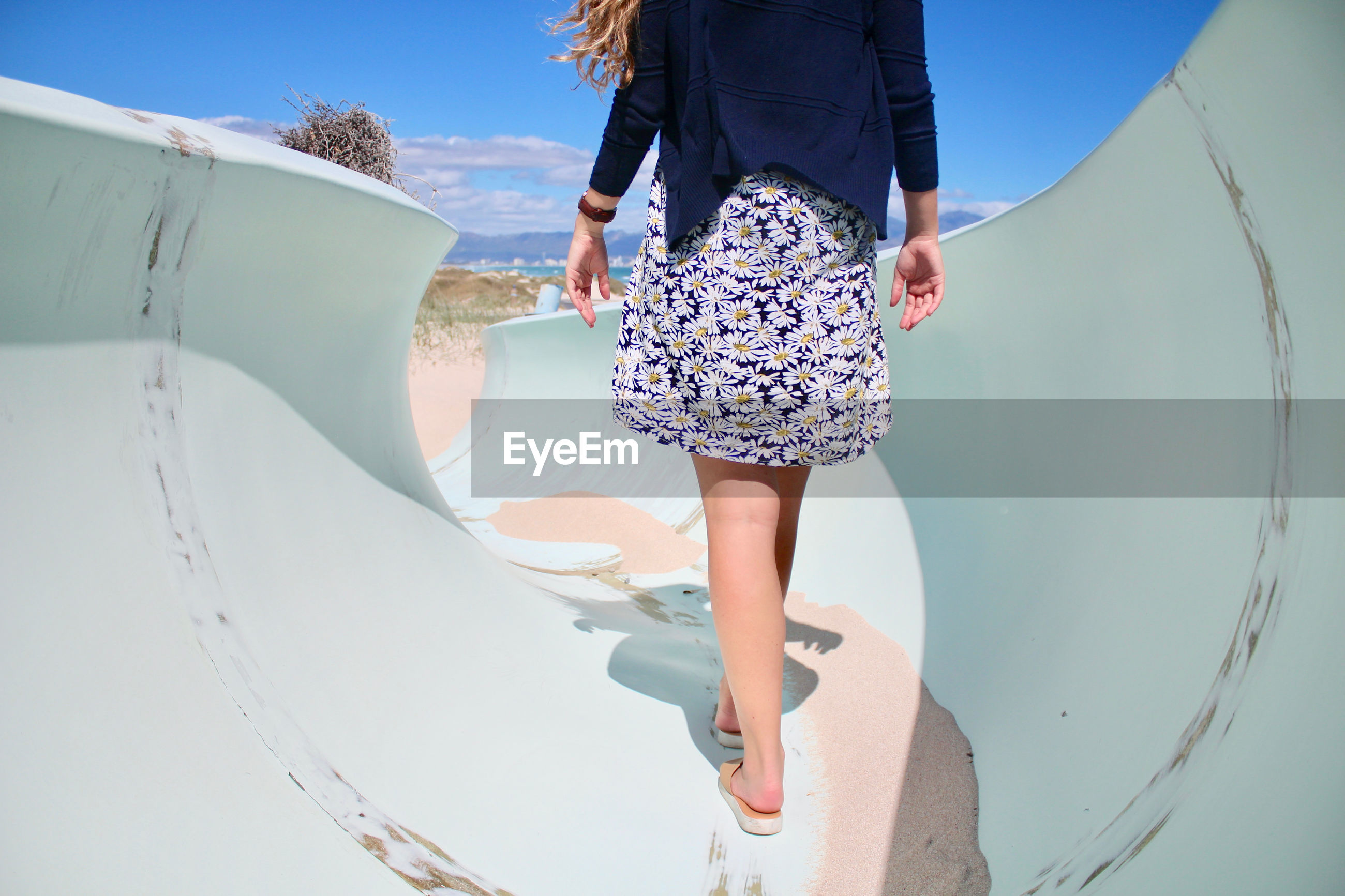 Low section of woman walking on slide