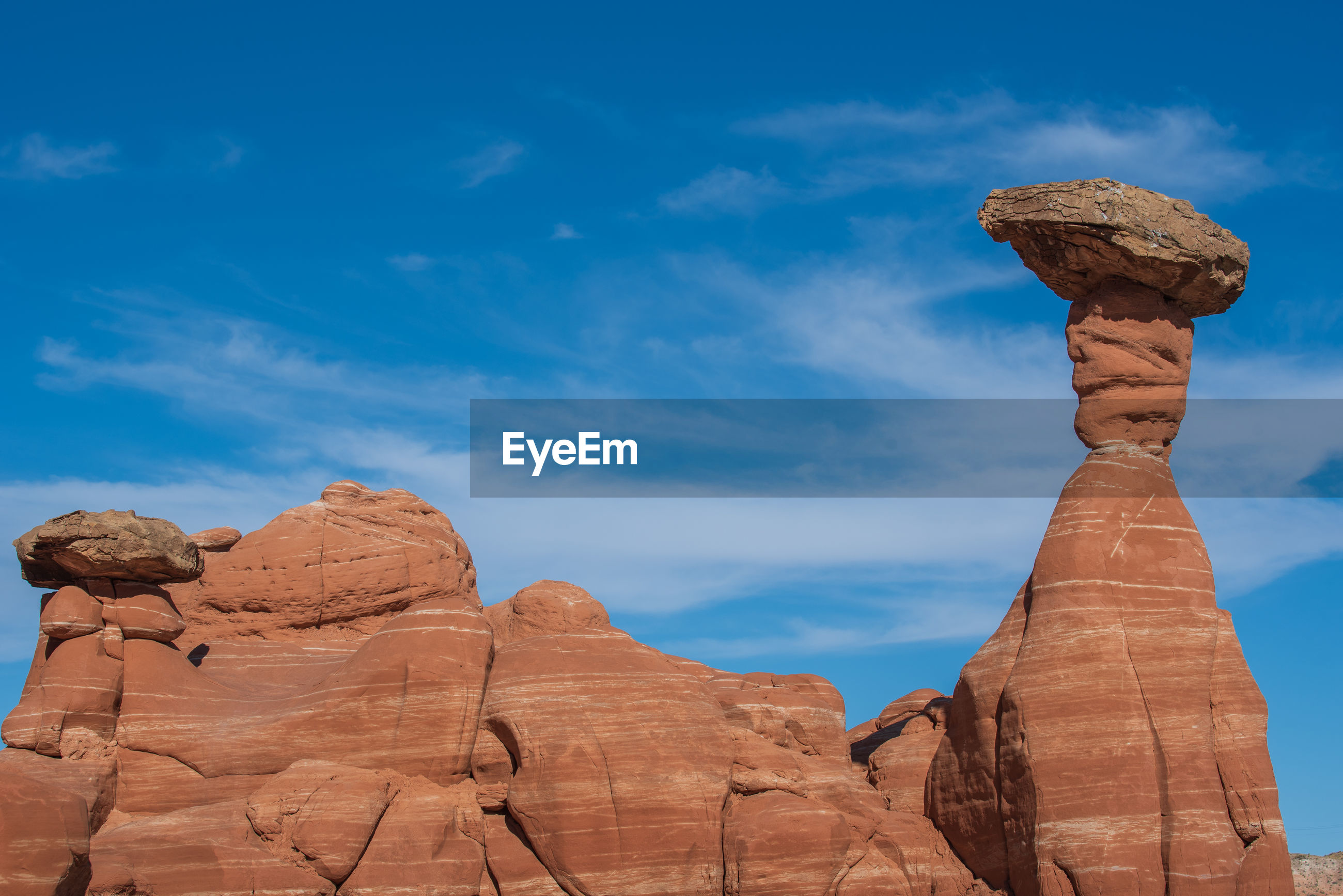 Landscape of brown striped hoodoos at the toadstools hike in grand staircase escalante in utah