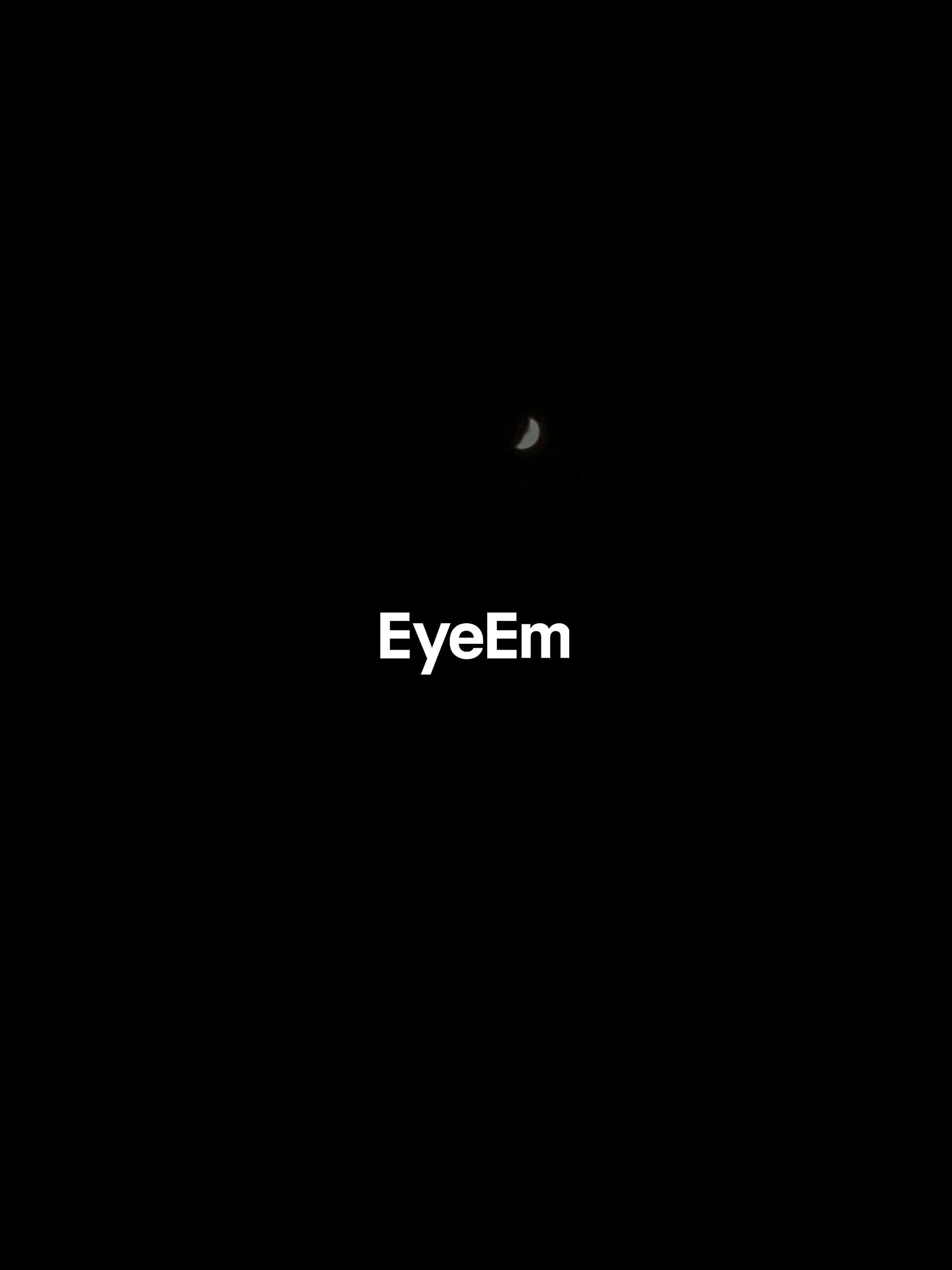 LOW ANGLE VIEW OF SILHOUETTE MOON AGAINST CLEAR SKY