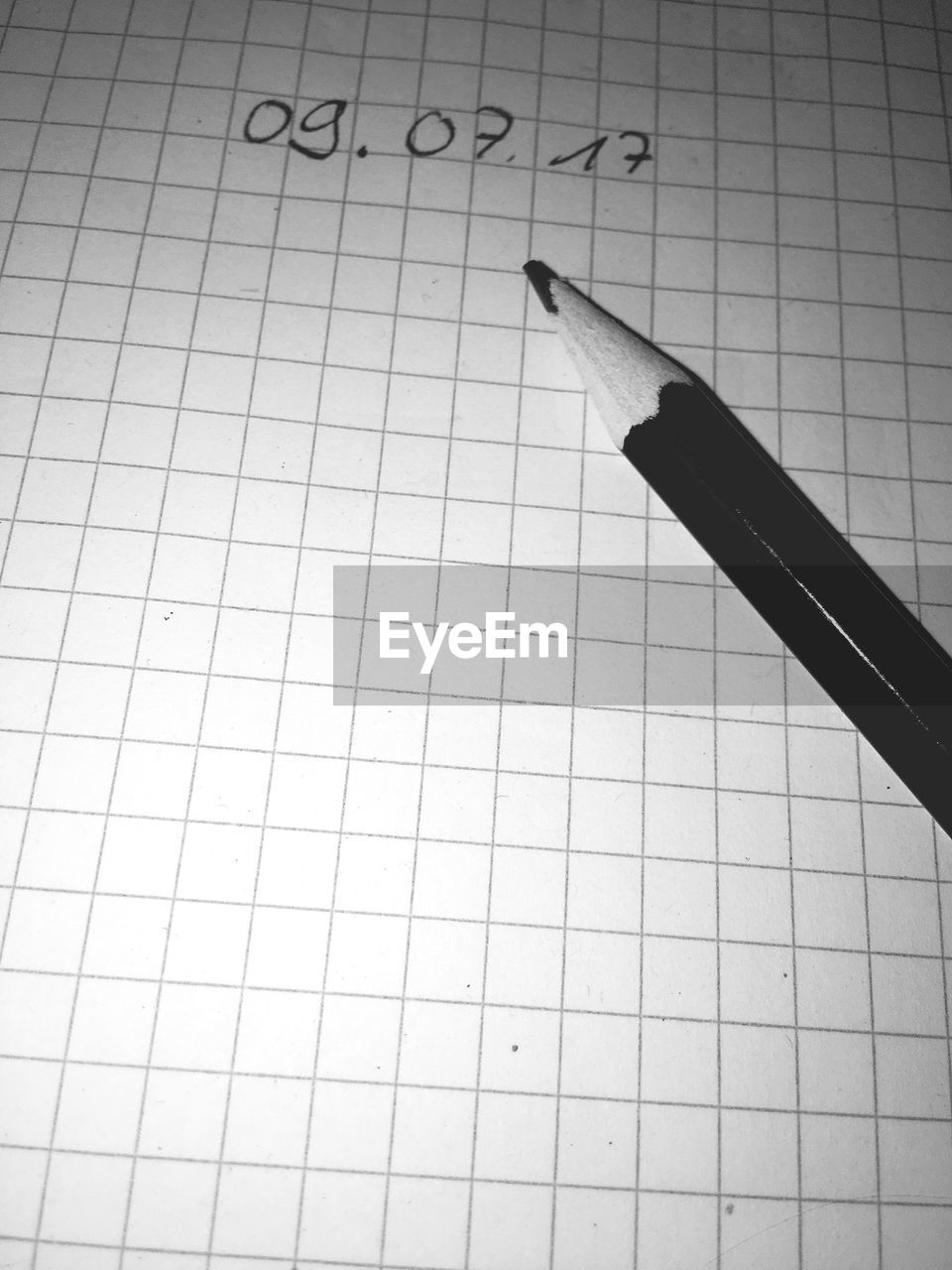 High angle view of pencil by numbers on book