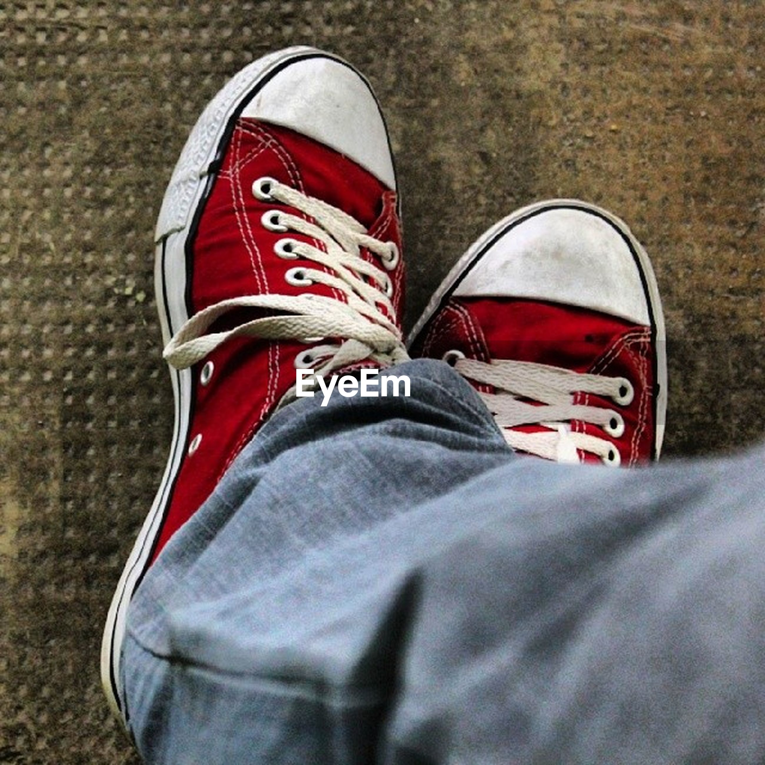 shoe, red, low section, patriotism, person, close-up, footwear, canvas shoe, identity, striped, flag, white color, lifestyles, standing, day, american flag, national flag, jeans