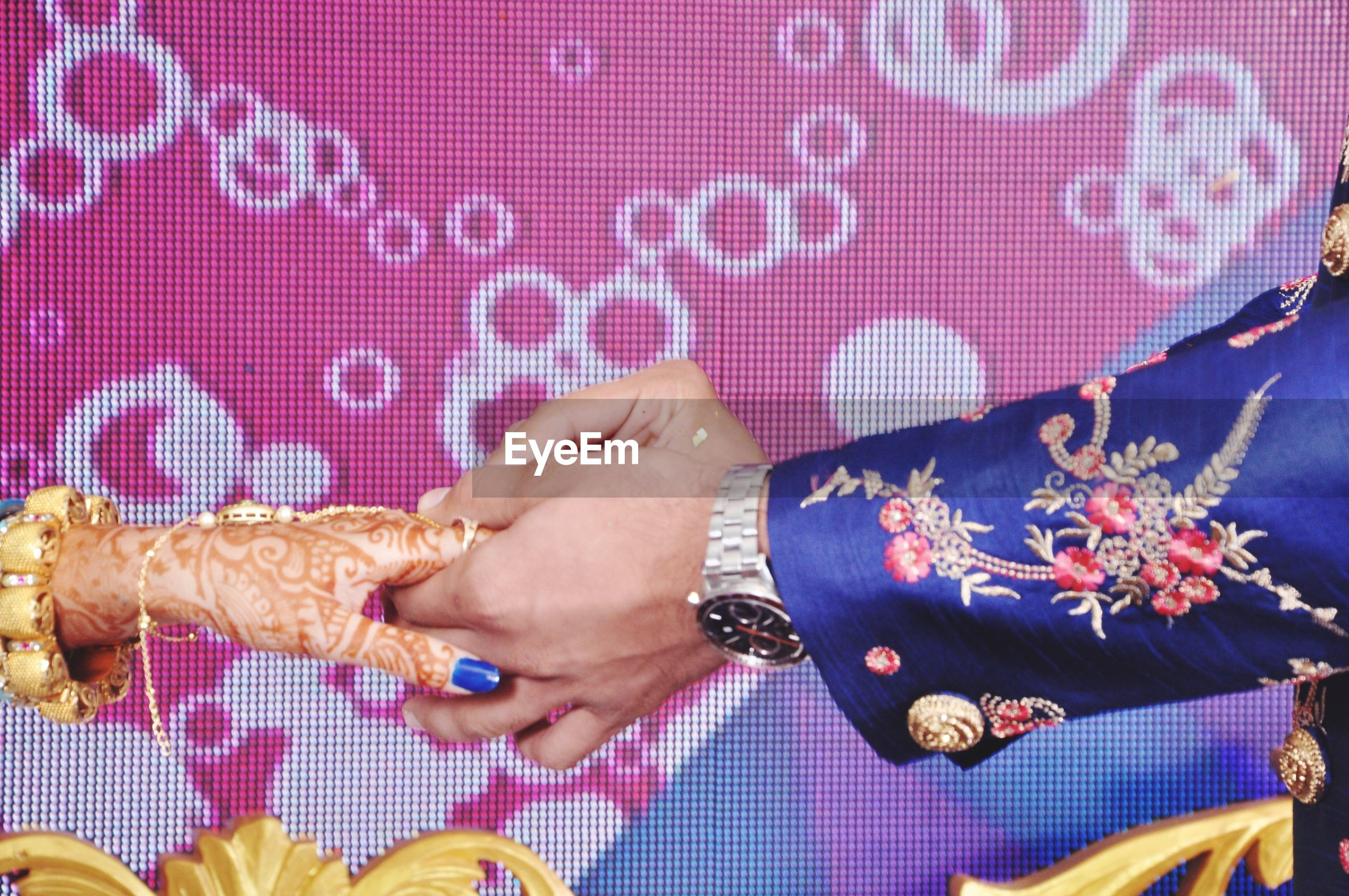 Cropped hand of couple exchanging wedding ring