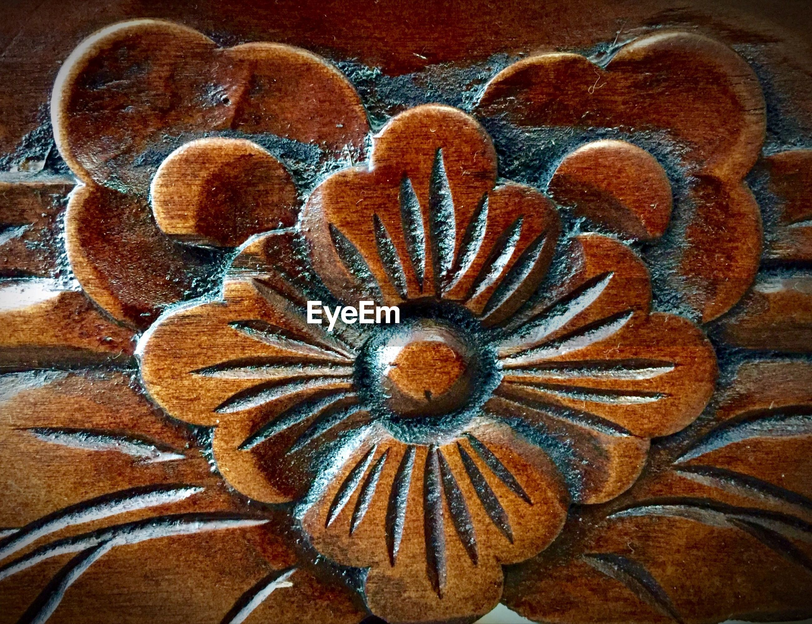 Close-up of craved wooden flower