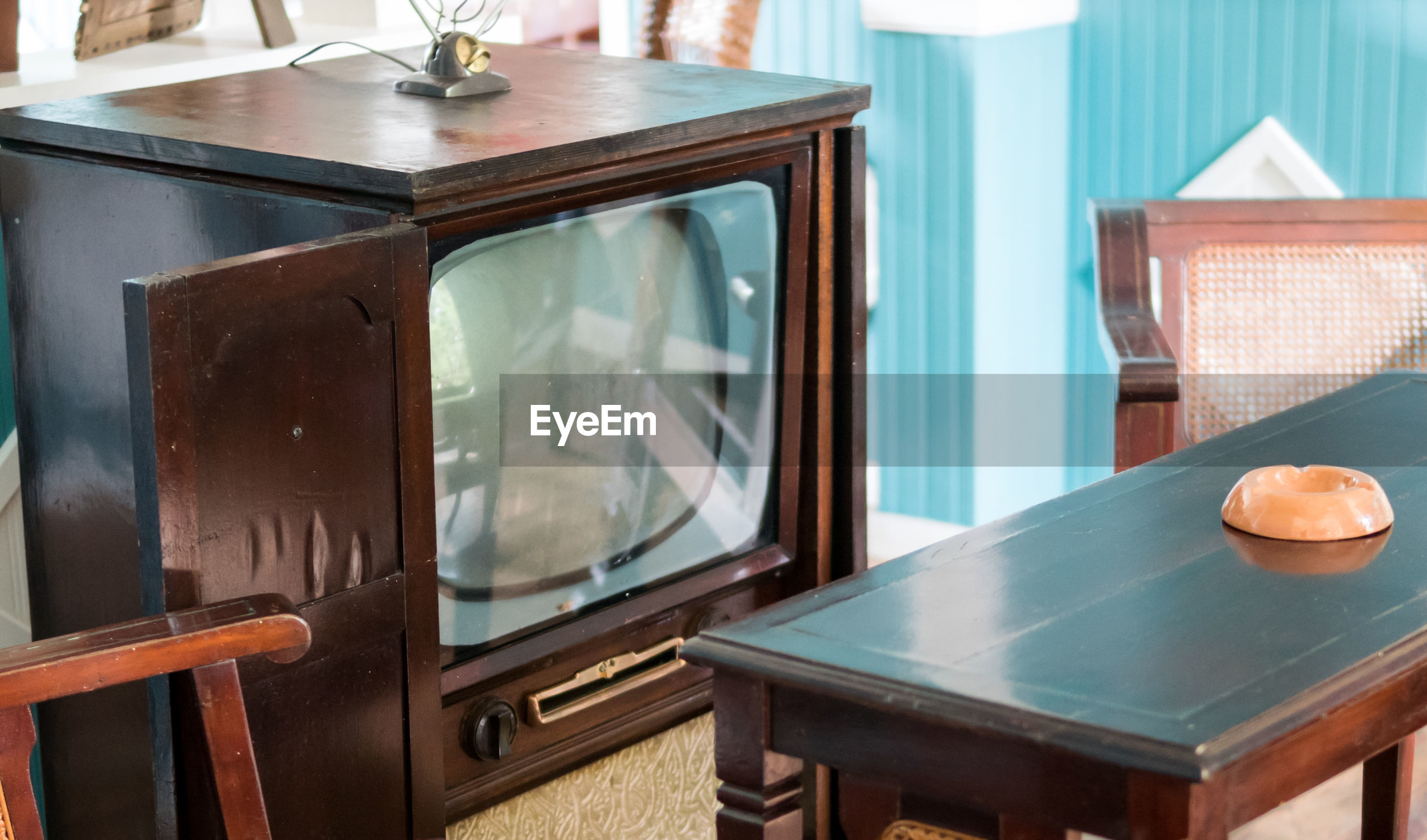 Close-up of table with television set at home