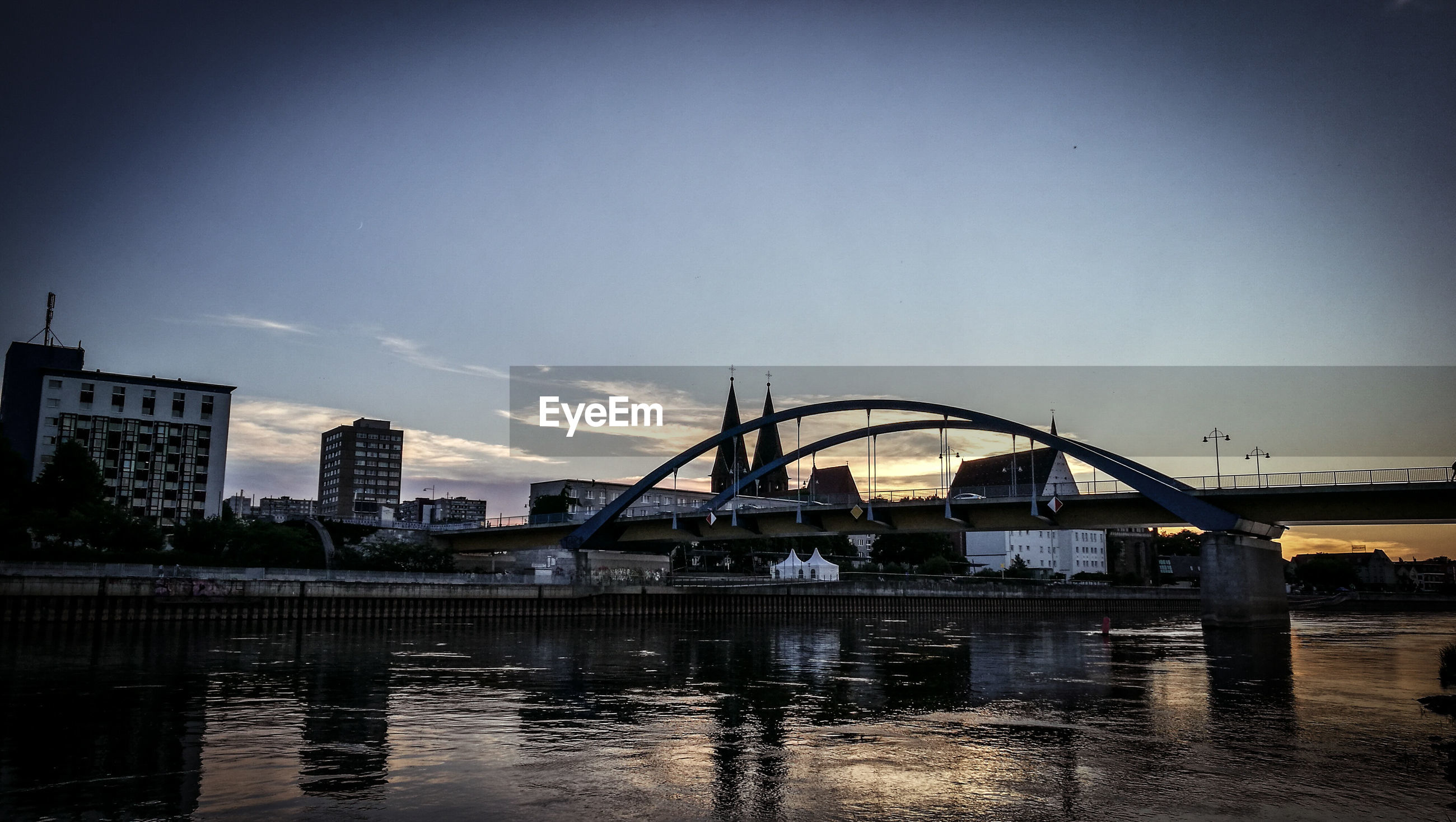 architecture, water, built structure, connection, river, bridge - man made structure, sky, city, bridge, engineering, outdoors, no people, travel destinations, city life, rippled, nature, illuminated, vignette
