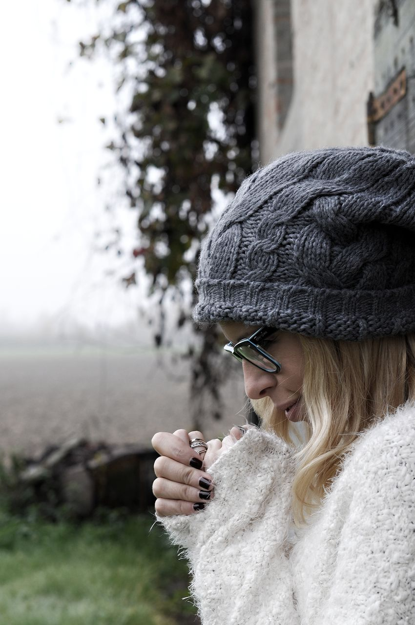 warm clothing, real people, one person, young women, young adult, winter, knit hat, outdoors, leisure activity, focus on foreground, fashion, day, headshot, beautiful woman, cold temperature, lifestyles, wireless technology, close-up, nature, people