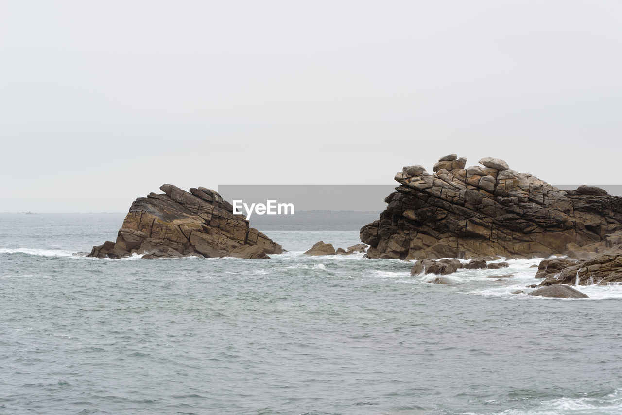 water, sea, waterfront, rock, sky, beauty in nature, rock - object, solid, scenics - nature, nature, tranquility, clear sky, day, rock formation, no people, tranquil scene, copy space, horizon, idyllic, outdoors, horizon over water, marine, stack rock