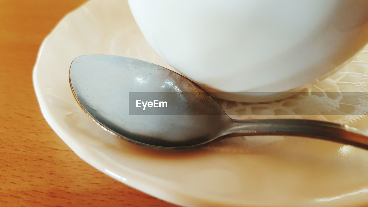 spoon, kitchen utensil, eating utensil, still life, close-up, food and drink, table, indoors, cup, food, white color, freshness, high angle view, no people, mug, saucer, crockery, coffee cup, coffee, selective focus, temptation, teaspoon