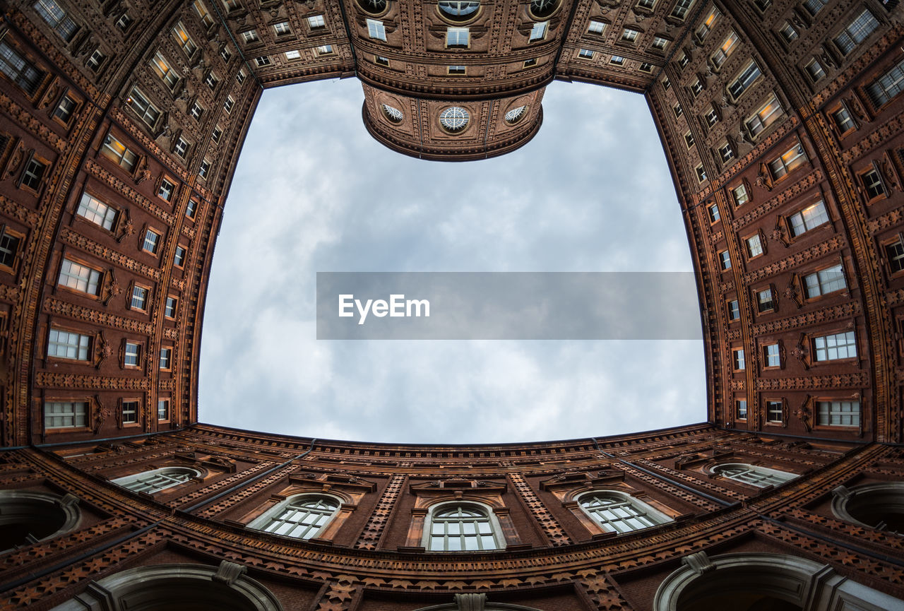 architecture, built structure, building exterior, low angle view, sky, tourism, travel destinations, building, no people, city, day, cloud - sky, arch, travel, nature, the past, history, outdoors, tower, directly below, ceiling