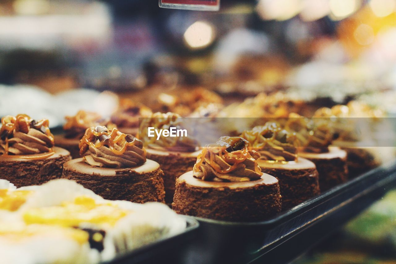 Close-Up Of Desserts For Sale In Shop