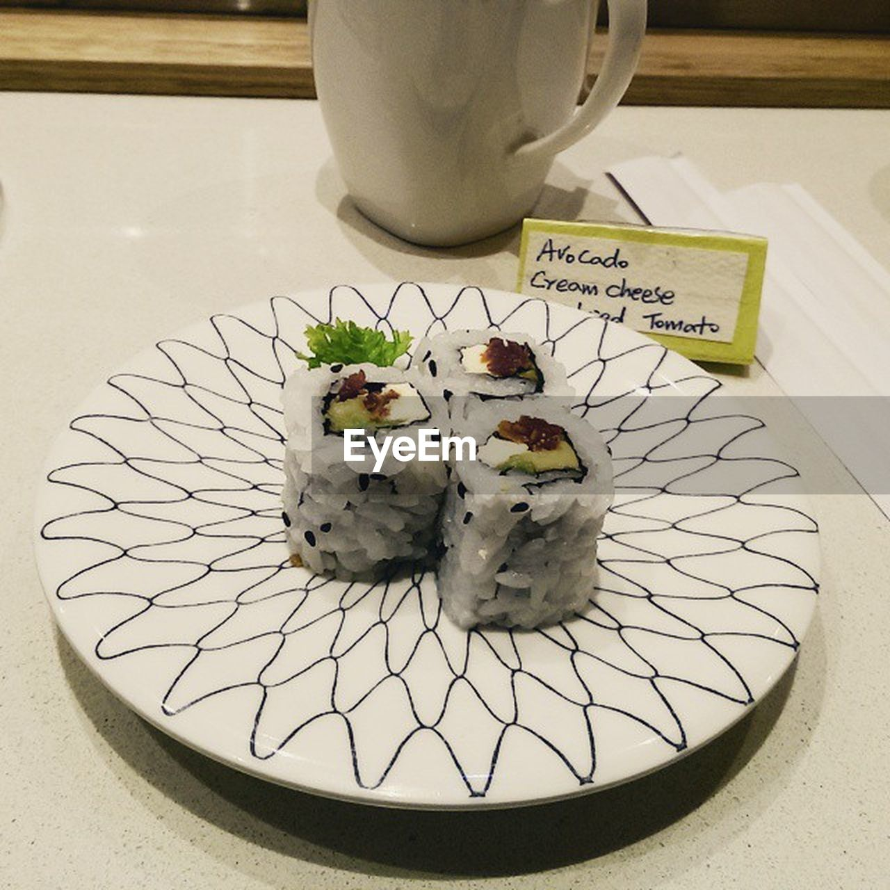 food and drink, still life, no people, indoors, text, communication, plate, food, high angle view, table, freshness, ready-to-eat, sushi, tray, close-up, day