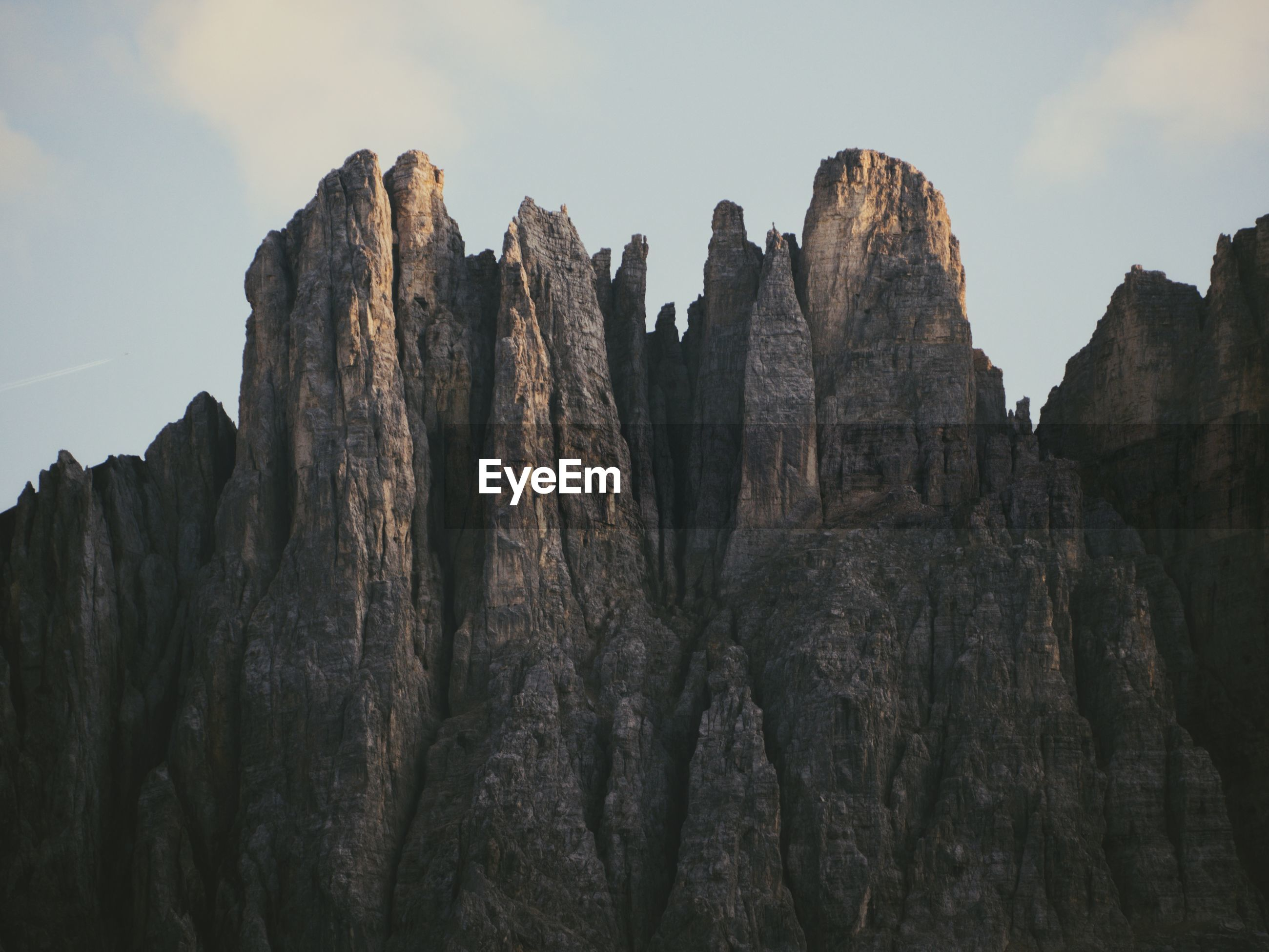 Low angle view of rock formations against sky in dolomites
