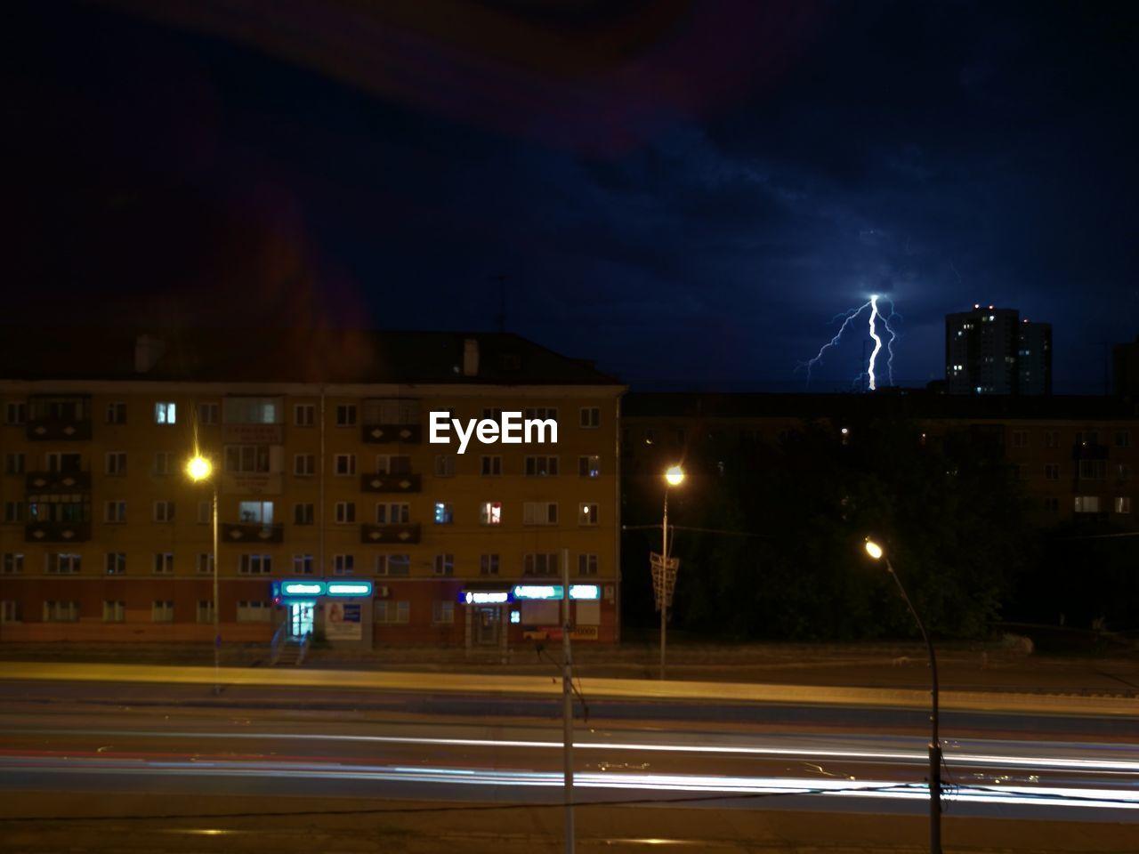 night, illuminated, building exterior, architecture, built structure, street light, outdoors, sky, city, no people, lightning, thunderstorm