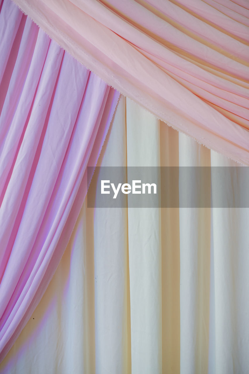 textile, no people, indoors, backgrounds, full frame, curtain, close-up, pink color, pattern, white color, side by side, still life, arrangement, multi colored, day, textile industry, hanging, red, window, striped