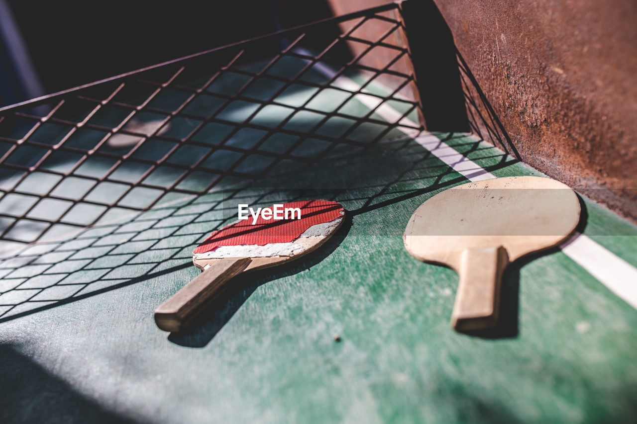 High angle view of tennis rackets on table