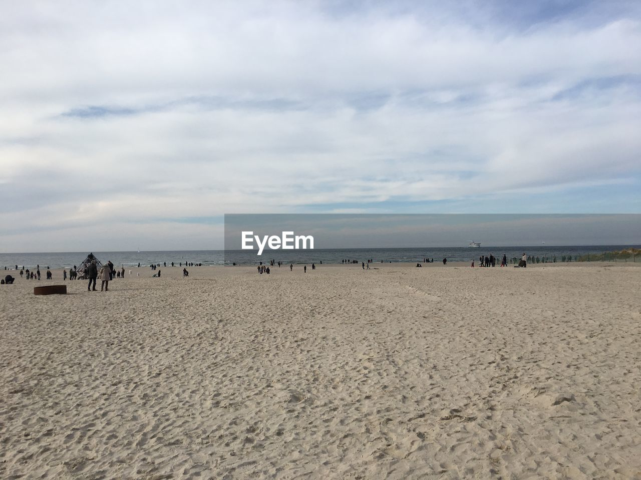 land, beach, cloud - sky, sky, sand, sea, water, horizon, scenics - nature, horizon over water, nature, beauty in nature, tranquility, tranquil scene, day, incidental people, outdoors, trip, holiday