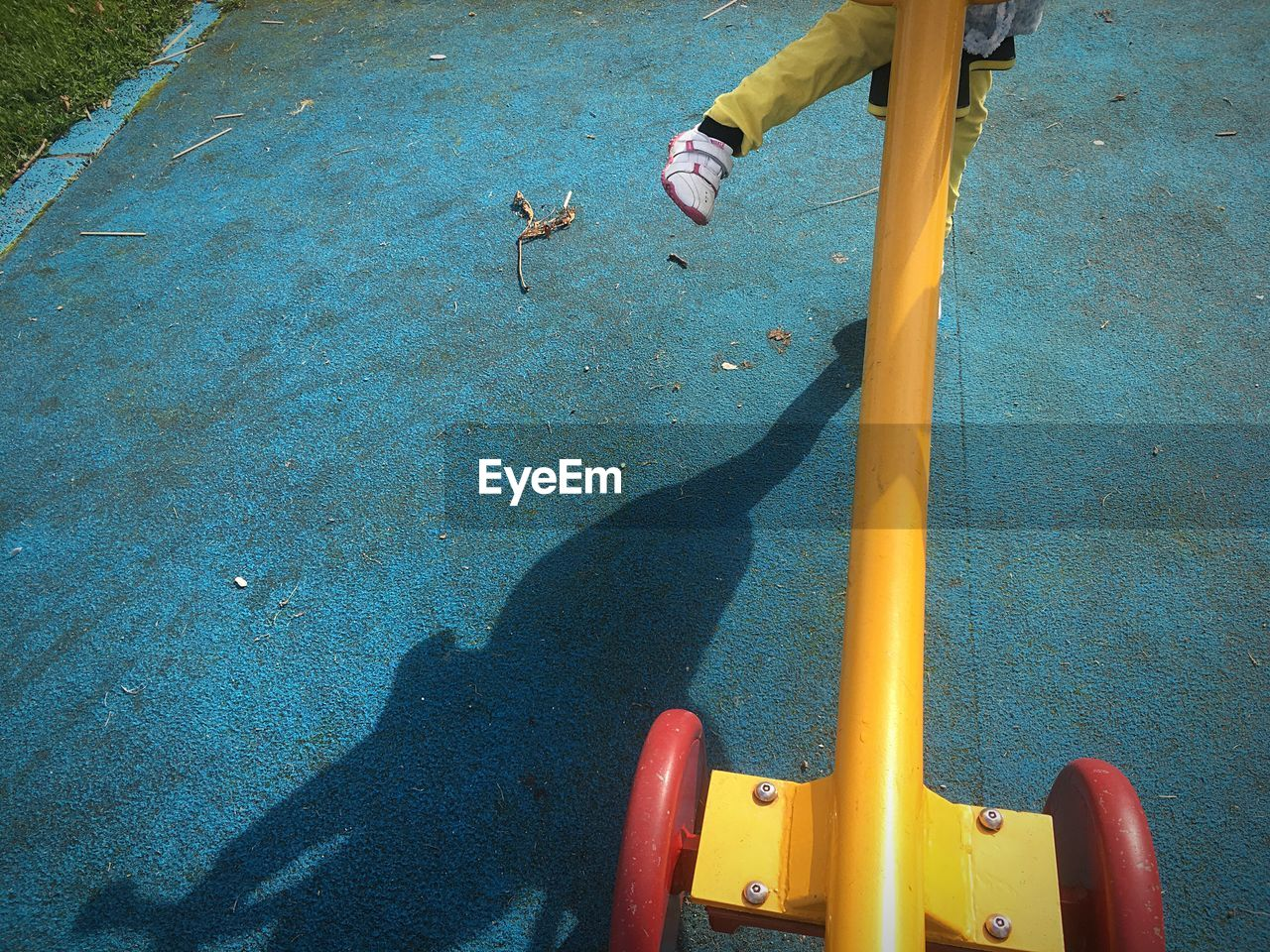 Low section of child playing in playground