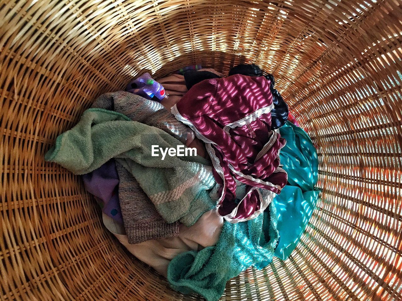 High Angle View Of Clothes On Wicker Basket