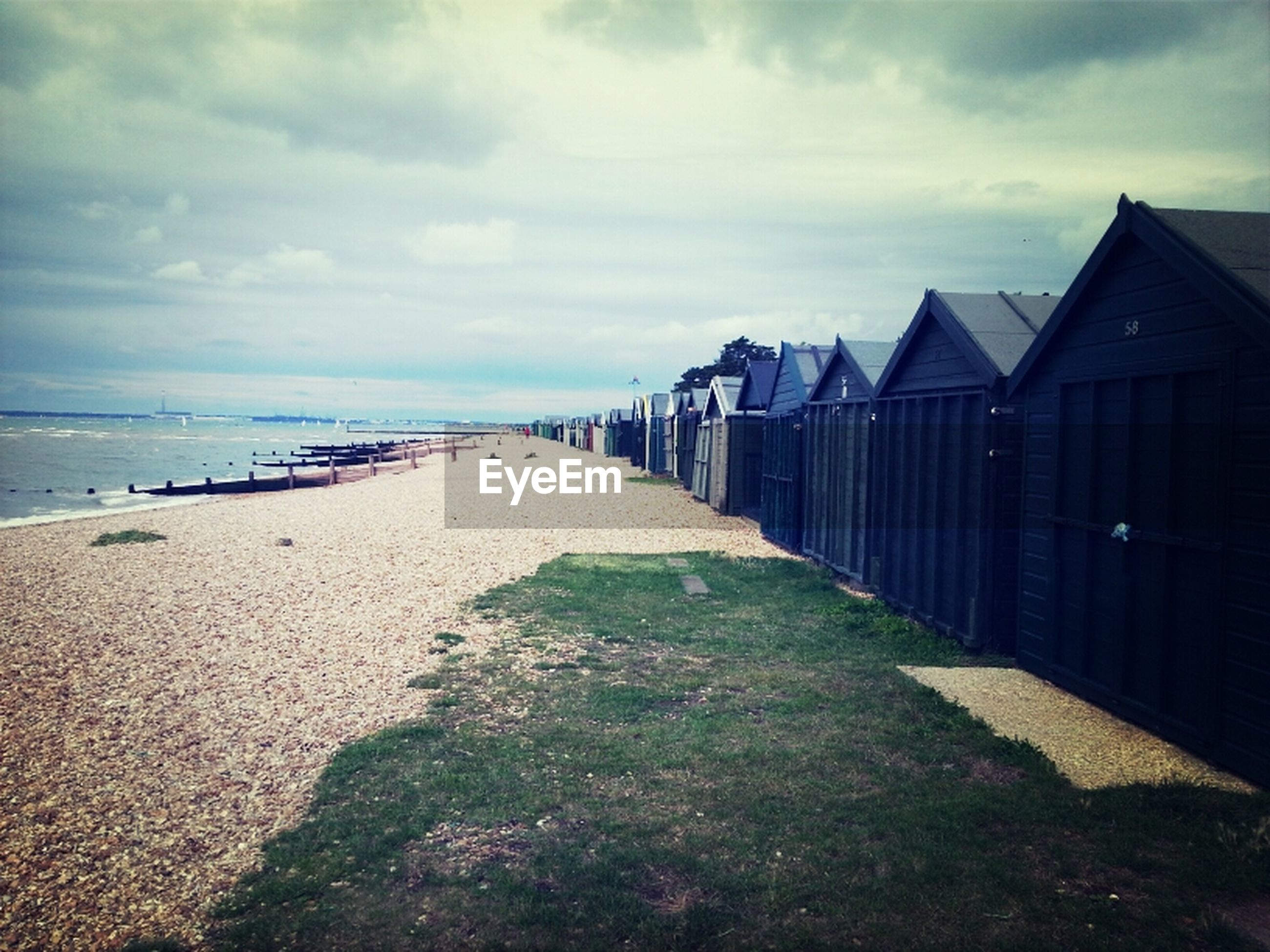 sea, beach, sky, water, horizon over water, sand, shore, cloud - sky, tranquil scene, built structure, tranquility, scenics, cloud, architecture, beauty in nature, cloudy, nature, building exterior, incidental people, the way forward