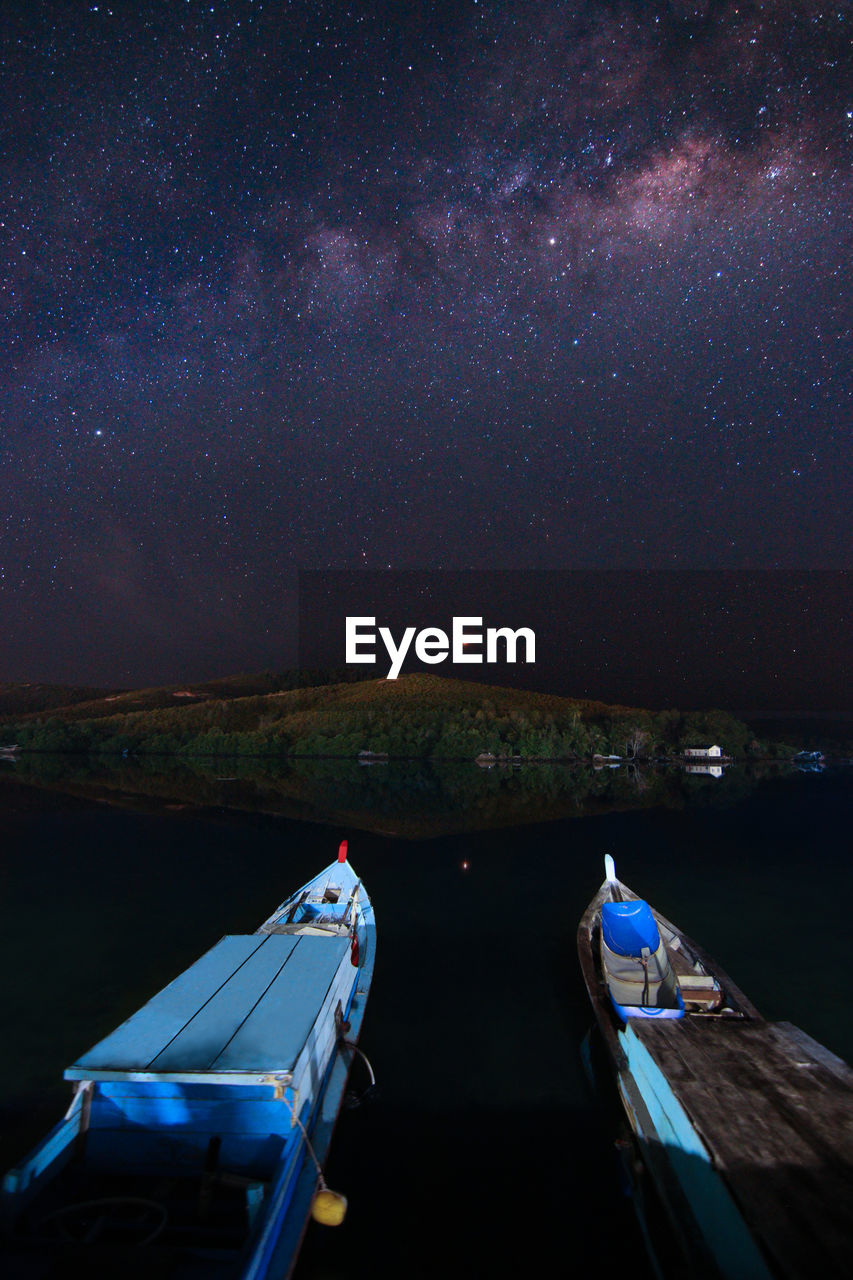 night, sky, star - space, water, beauty in nature, scenics - nature, nature, space, architecture, astronomy, transportation, nautical vessel, star, built structure, star field, tranquility, galaxy, illuminated, no people, outdoors, milky way, space and astronomy