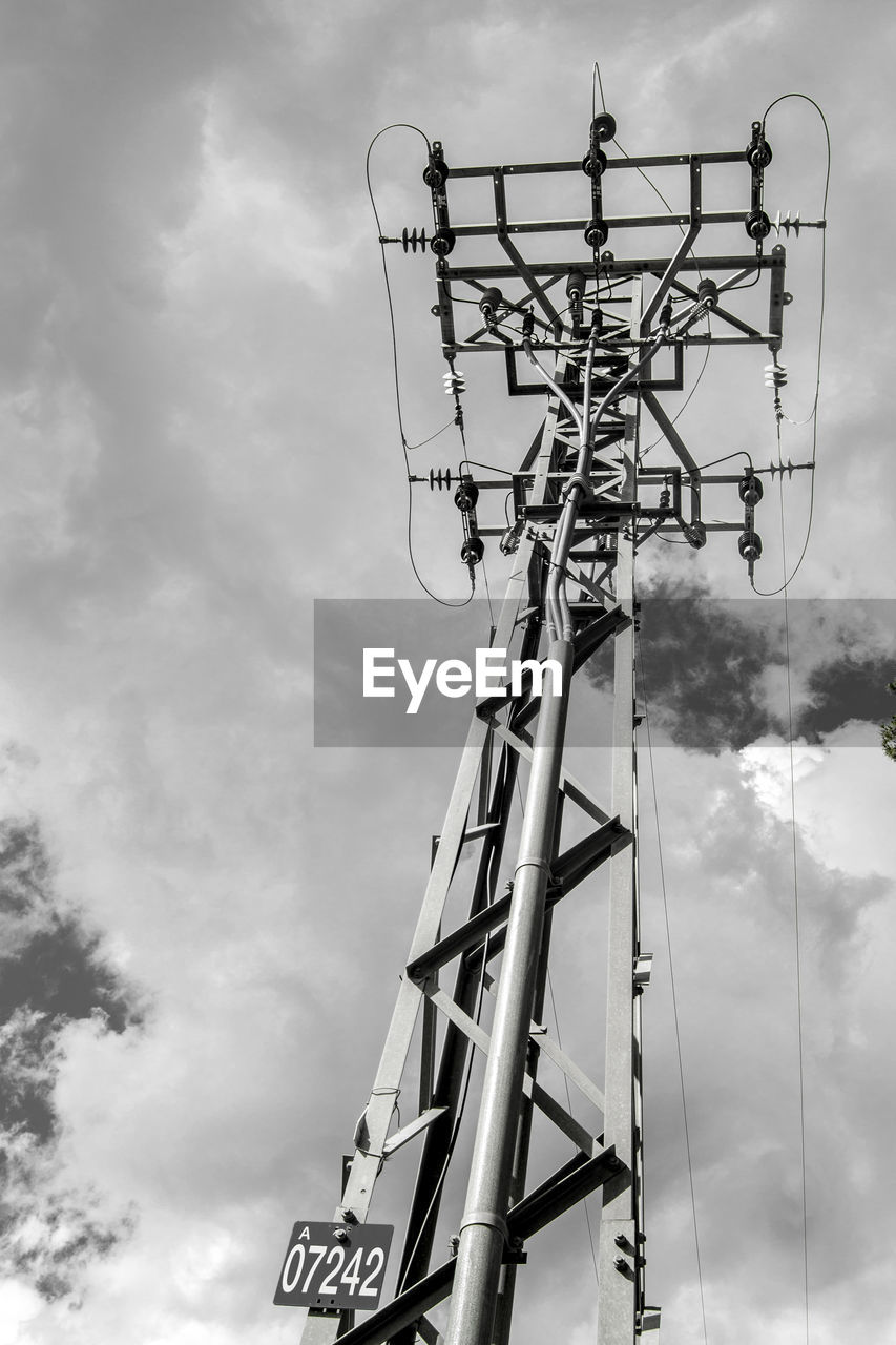 cloud - sky, sky, low angle view, technology, day, outdoors, cable, electricity, fuel and power generation, no people, electricity pylon
