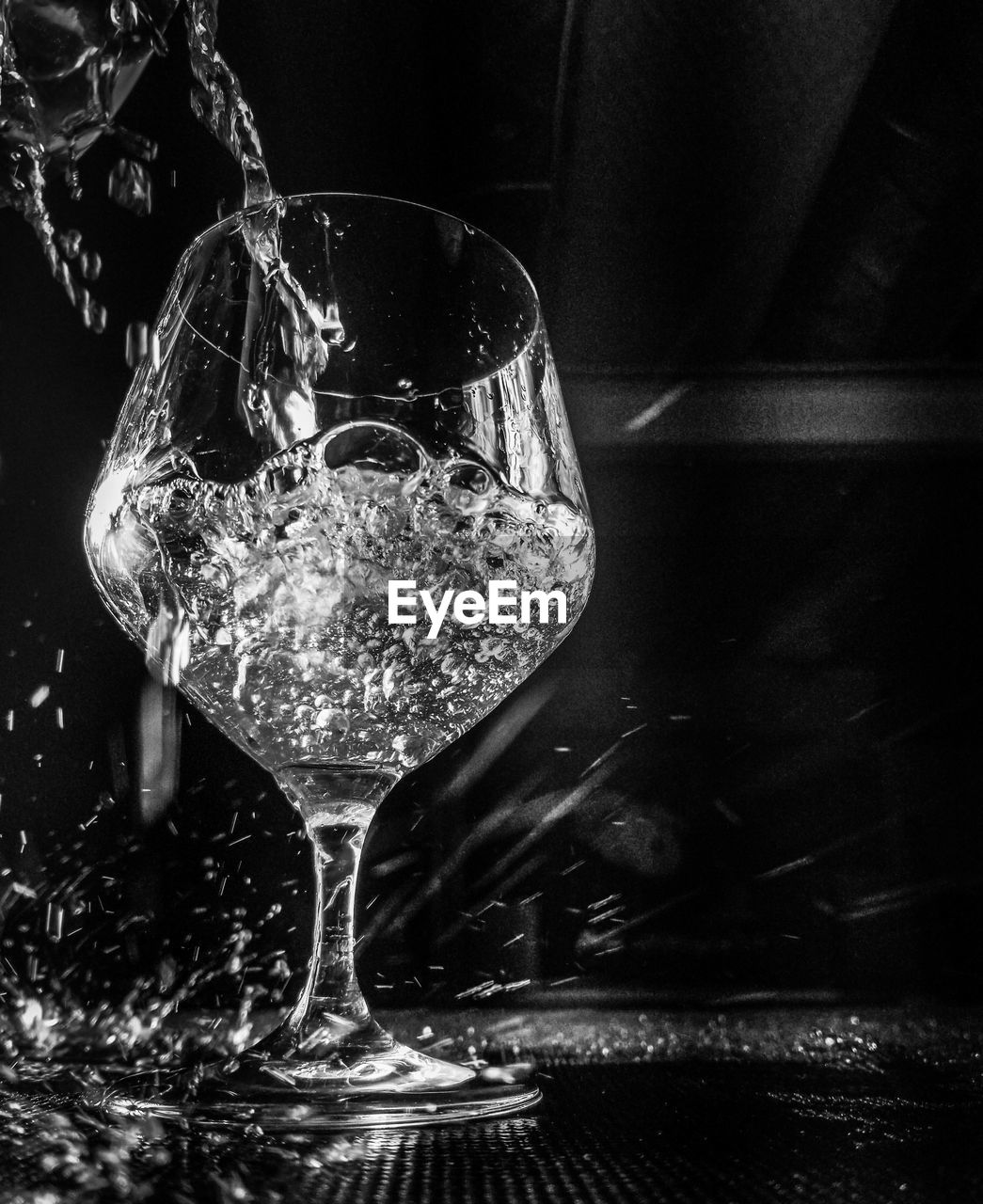 glass, refreshment, food and drink, drink, alcohol, wineglass, indoors, glass - material, transparent, wine, no people, close-up, freshness, still life, drinking glass, household equipment, focus on foreground, table, splashing, purity