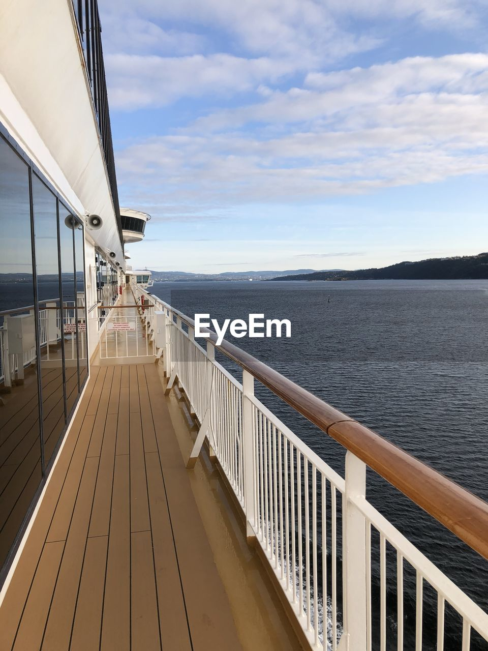 water, sky, railing, sea, cloud - sky, transportation, nature, scenics - nature, architecture, nautical vessel, day, built structure, beauty in nature, deck, boat deck, direction, mode of transportation, travel, the way forward, outdoors, no people, cruise ship, diminishing perspective