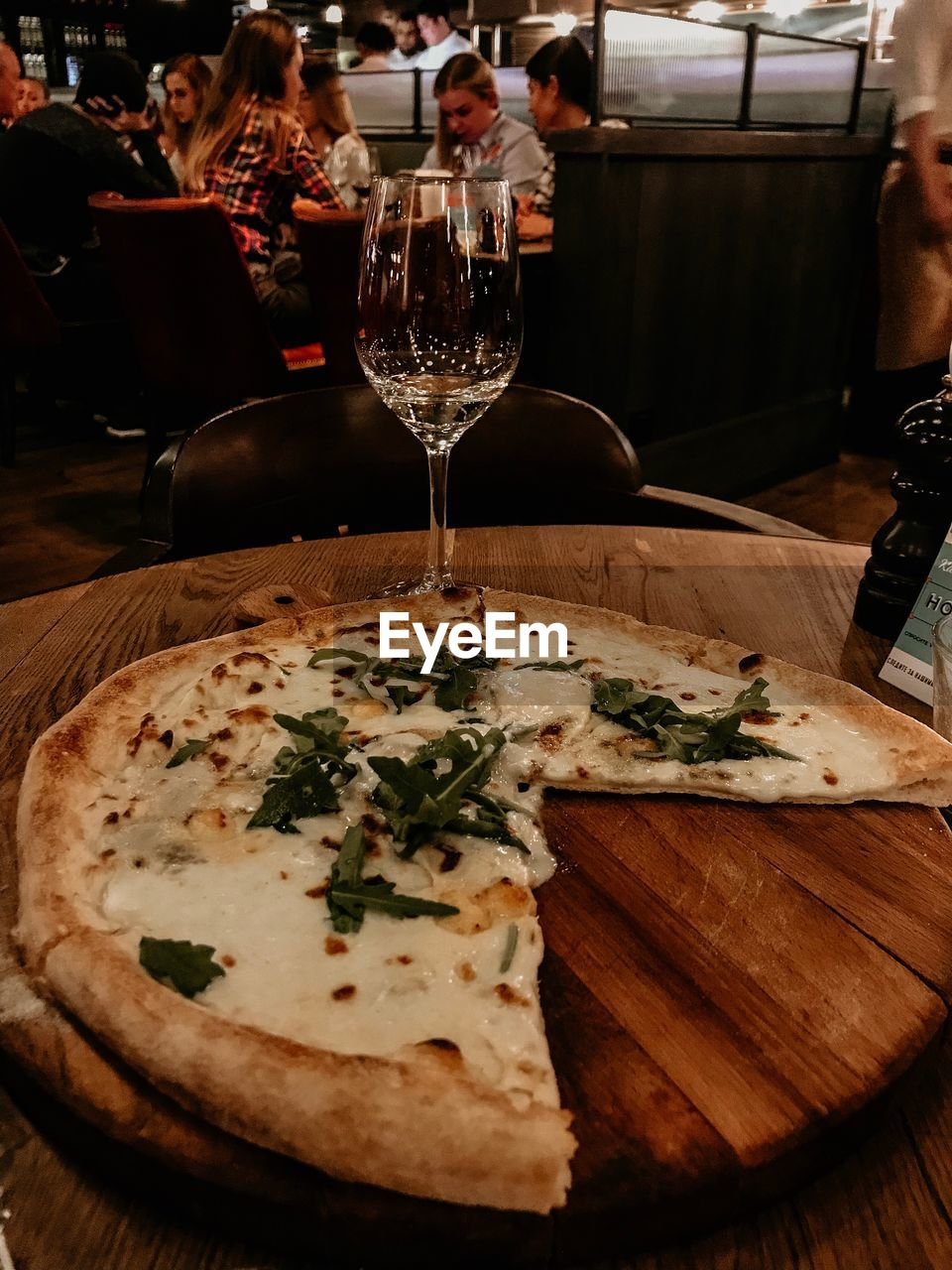 food and drink, table, food, freshness, indoors, restaurant, business, drink, ready-to-eat, incidental people, refreshment, glass, alcohol, still life, pizza, wine, serving size, plate, wood - material, wineglass, dinner