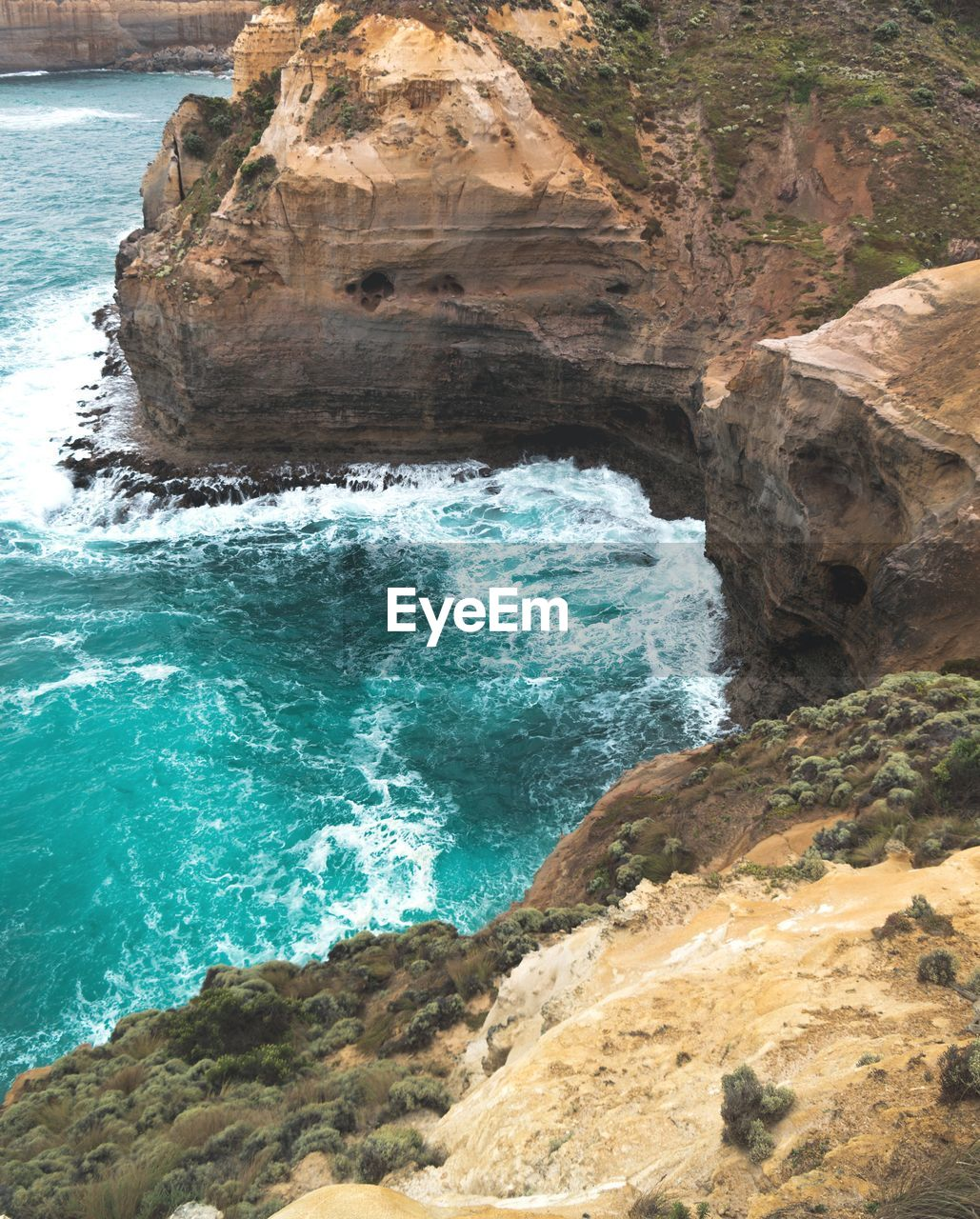 rock - object, rock formation, sea, beauty in nature, nature, water, rock, scenics, no people, day, outdoors, wave, motion, sunlight, power in nature, sky