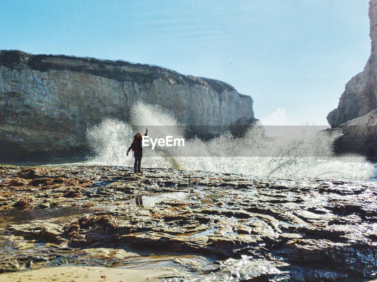 water, real people, nature, land, motion, sky, leisure activity, day, one person, lifestyles, beauty in nature, scenics - nature, rock, sea, men, full length, solid, rock - object, outdoors, power in nature