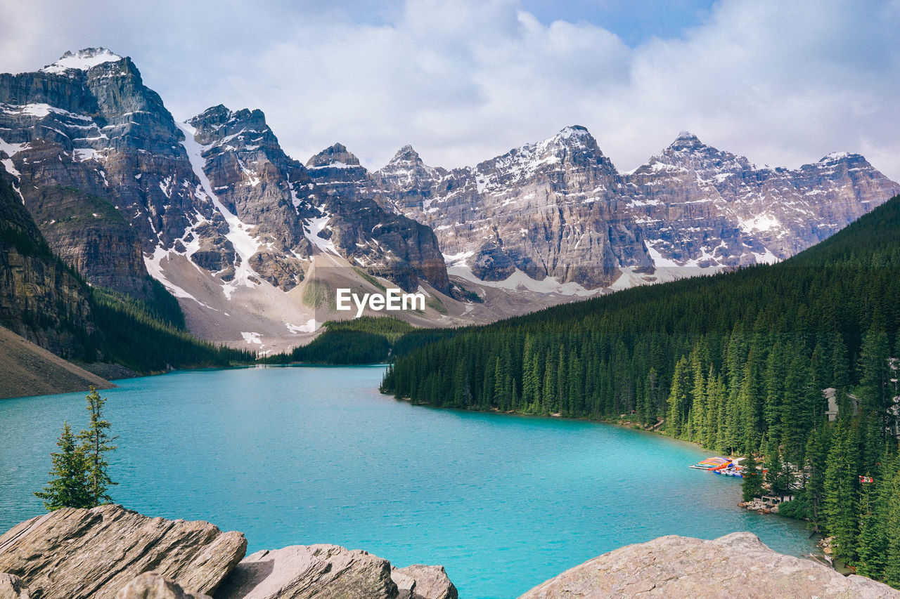 mountain, scenics - nature, beauty in nature, water, tranquil scene, sky, tranquility, mountain range, tree, lake, cloud - sky, non-urban scene, nature, plant, idyllic, day, no people, cold temperature, outdoors, snowcapped mountain, mountain peak, turquoise colored