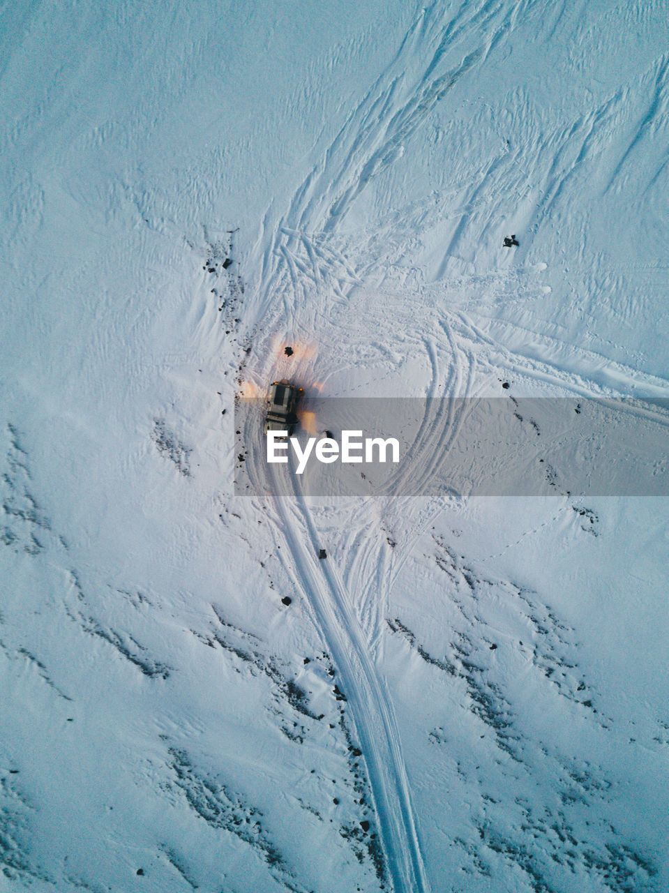 High Angle View Of Car On Snow Covered Landscape