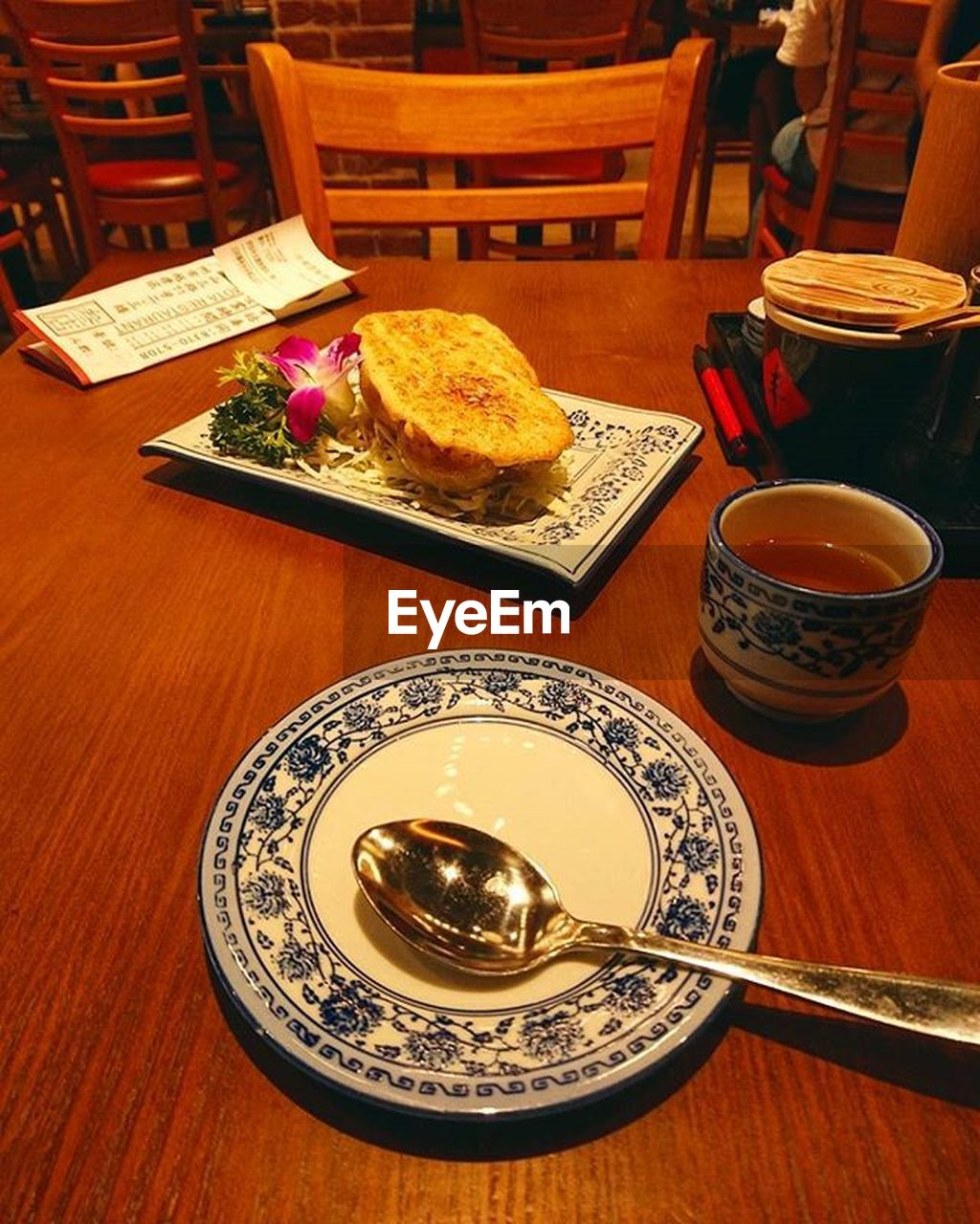 table, food and drink, cup, indoors, drink, plate, food, mug, kitchen utensil, refreshment, still life, freshness, wood - material, tea, ready-to-eat, crockery, high angle view, eating utensil, no people, tea cup, setting, breakfast