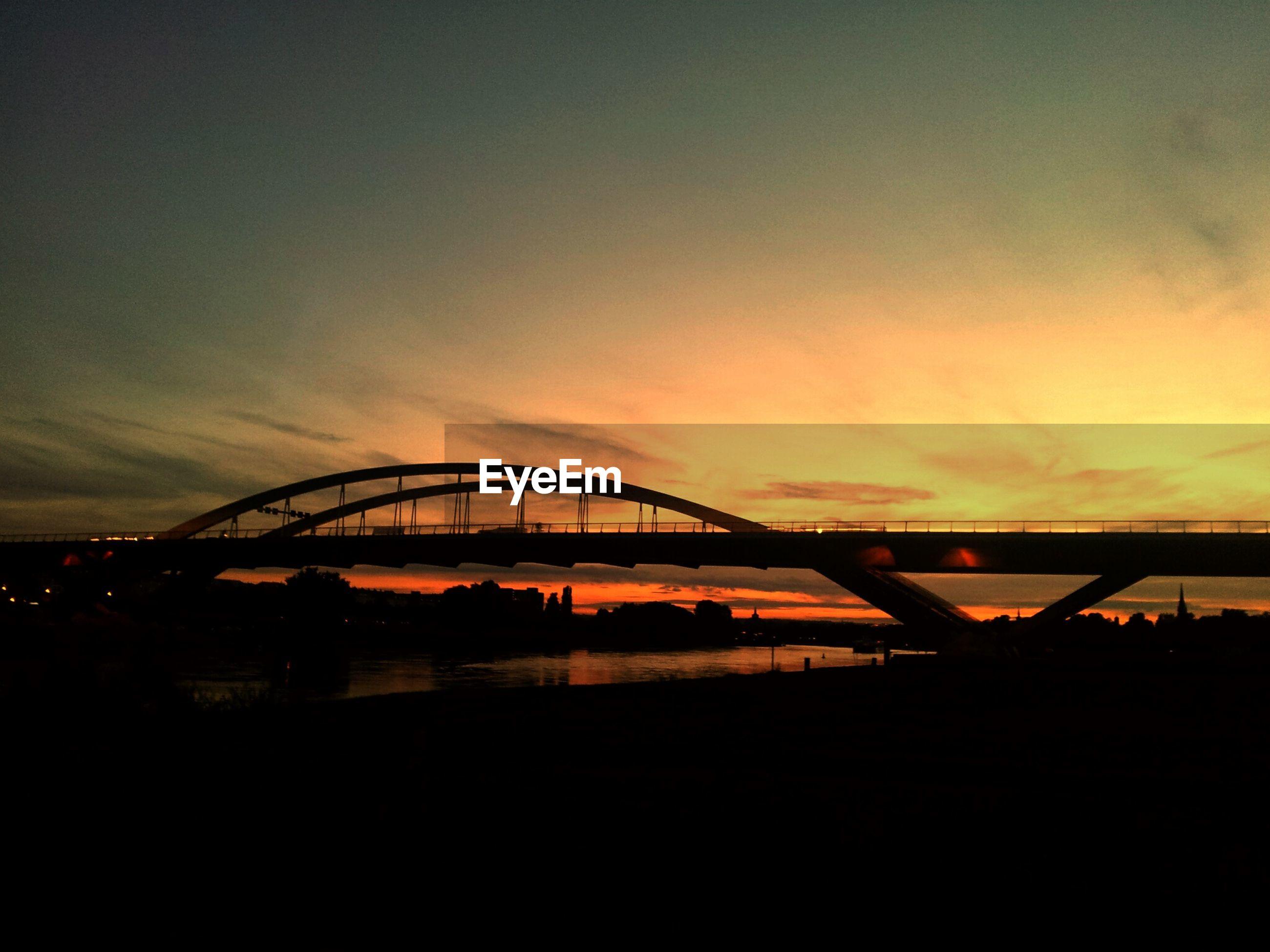 sunset, silhouette, connection, sky, bridge - man made structure, orange color, built structure, architecture, cloud - sky, bridge, engineering, river, sun, nature, scenics, dusk, cloud, tranquility, beauty in nature, no people